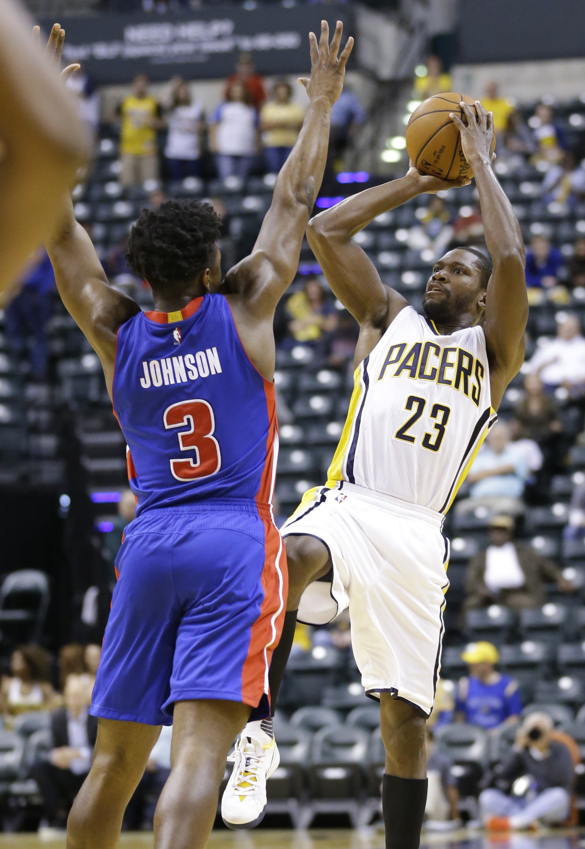 Indiana Pacers guard Toney Douglas (23) shoots over Detroit Pistons forward Stanley Johnson (3) during the second half of an NBA preseason basketball game in Indianapolis, Tuesday, Oct. 13, 2015. The Pacers defeated the Pistons 101-97. (AP Photo/Michael C