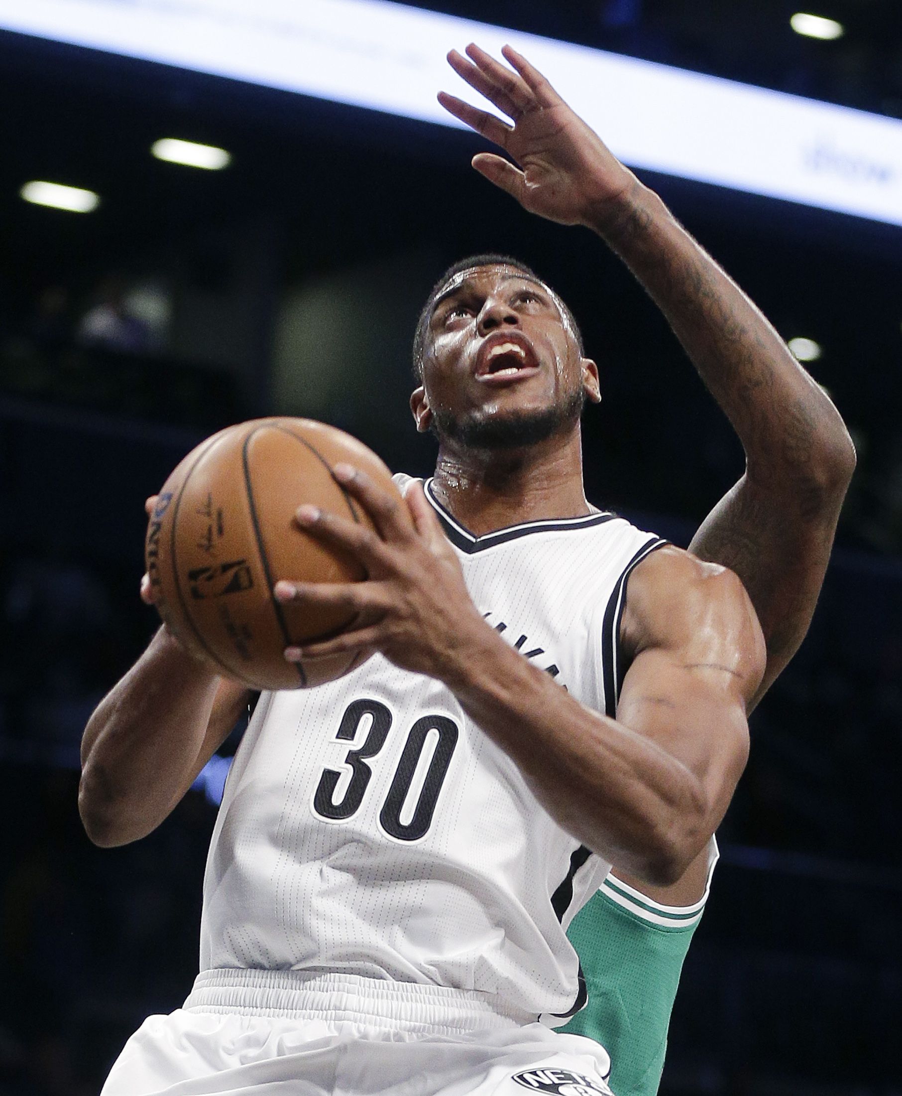 Brooklyn Nets forward Thaddeus Young (30) goes up for a shot against the Boston Celtics during the first quarter of a preseason NBA basketball game, Wednesday, Oct. 14, 2015, in New York. (AP Photo/Julie Jacobson)