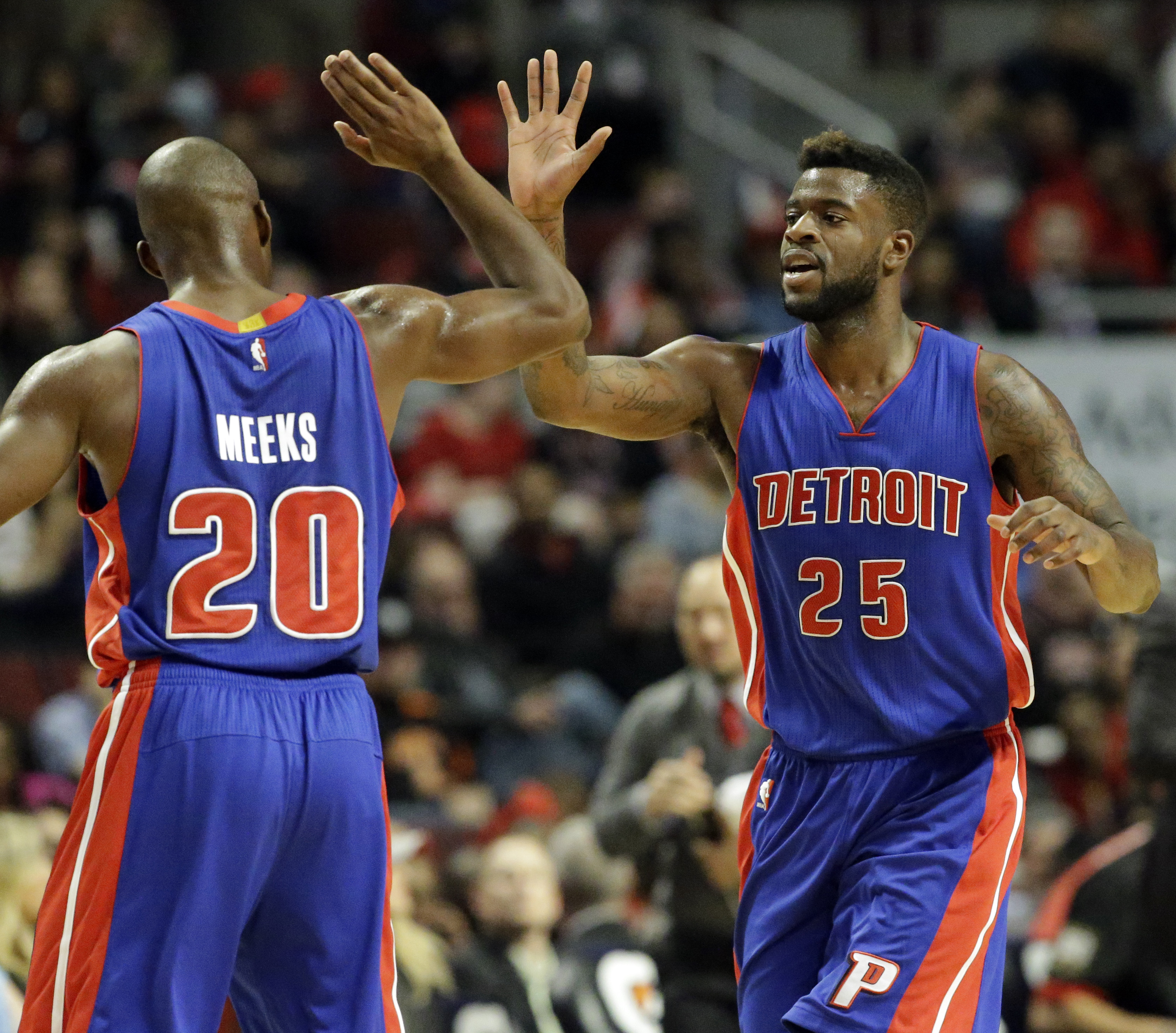 Detroit Pistons forward Reggie Bullock, right, celebrates with guard Jodie Meeks after scoring a basket during the second half of an NBA preseason basketball game against the Chicago Bulls on Wednesday, Oct. 14, 2015, in Chicago. The Pistons won 114-91. (