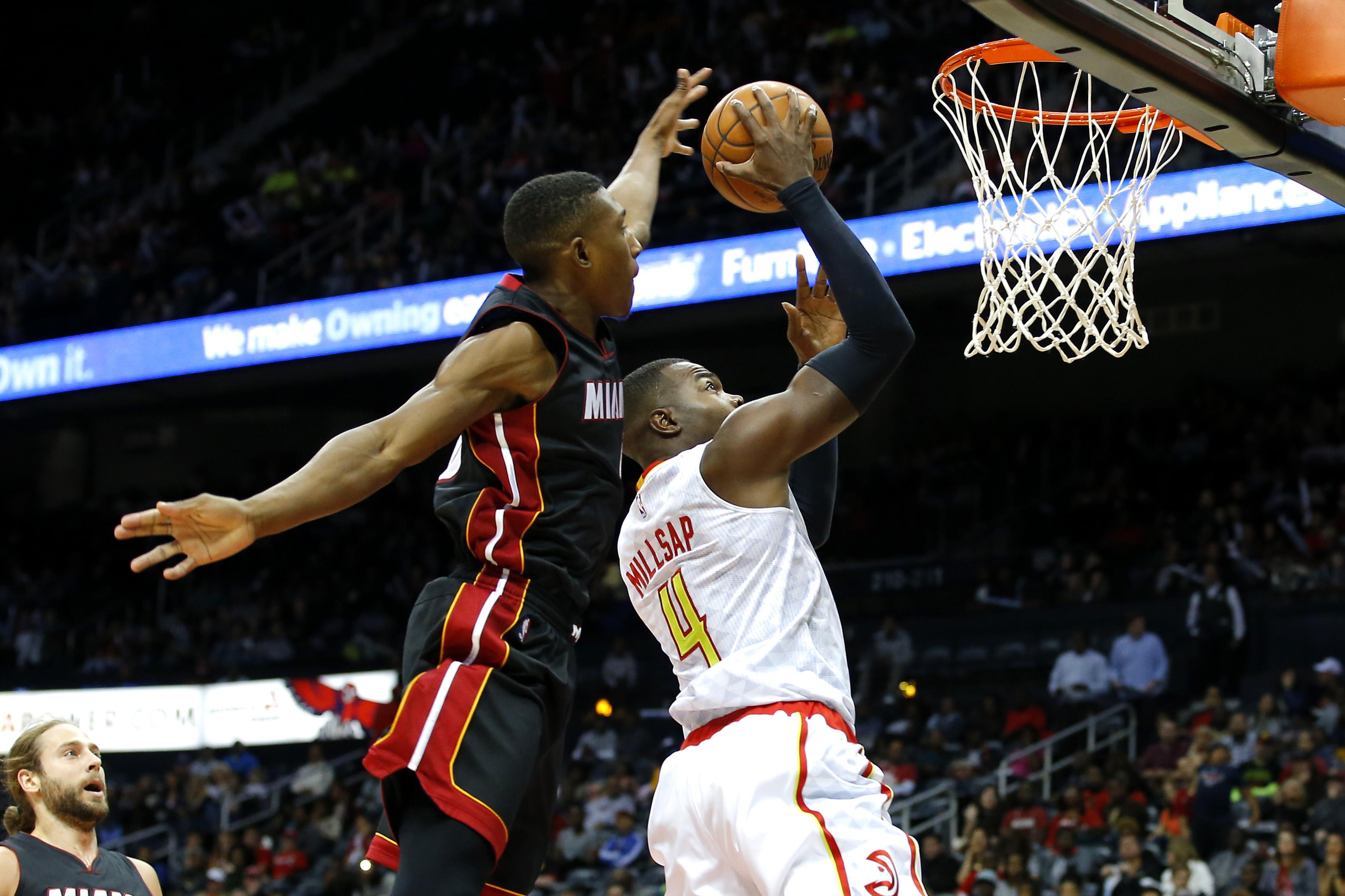 Miami Heat guard Josh Richardson (0) is called for a foul against Atlanta Hawks forward Paul Millsap (4) in the first half of a preseason NBA basketball game, Sunday, Oct. 18, 2015, in Atlanta. (AP Photo/Todd Kirkland)