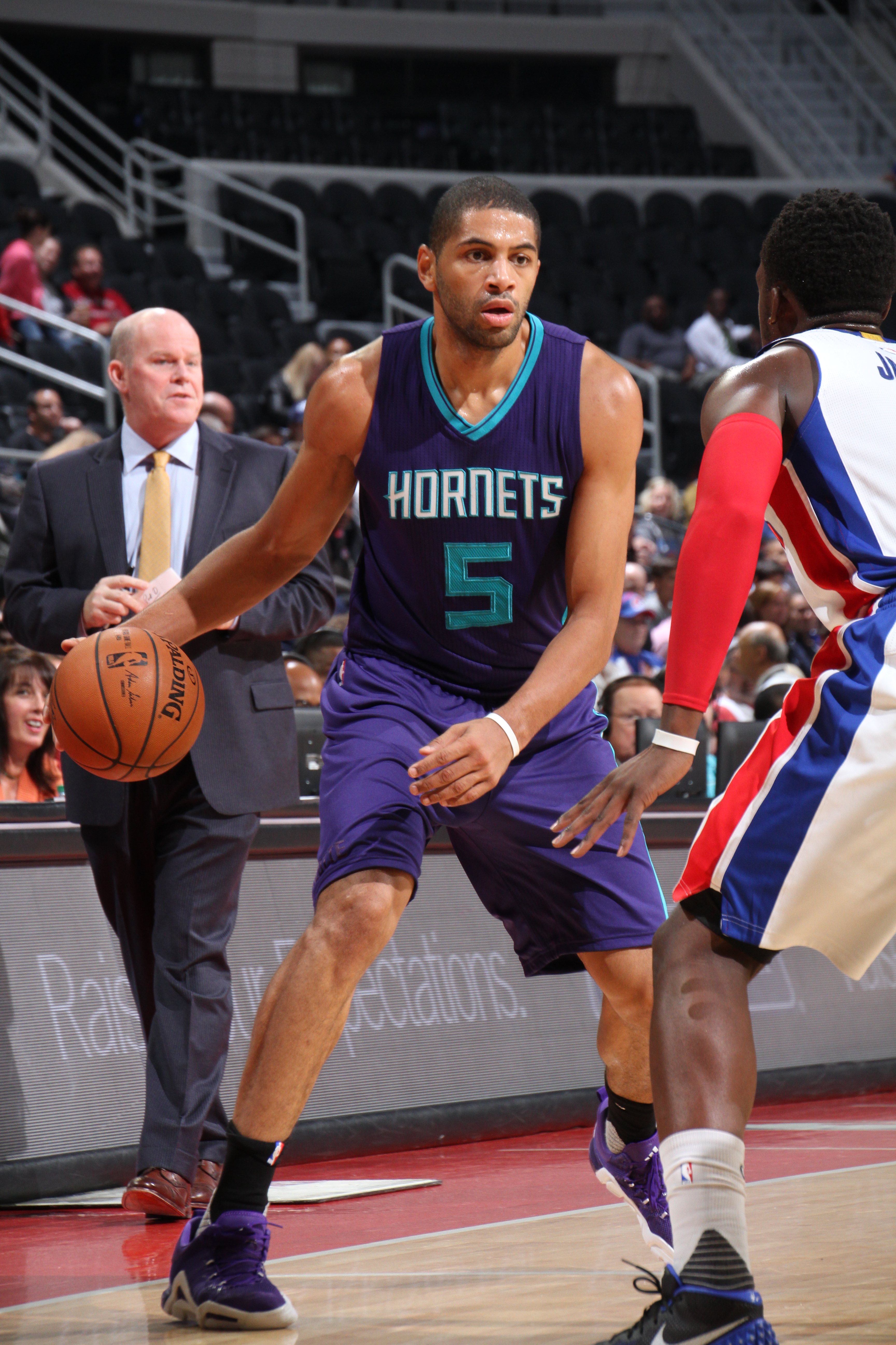 AUBURN HILLS, MI - OCTOBER 21:  Nicolas Batum #5 of the Charlotte Hornets handles the ball against the Detroit Pistons on October 21, 2015 at The Palace of Auburn Hills in Auburn Hills, Michigan. (Photo by B. Sevald/Einstein/NBAE via Getty Images)
