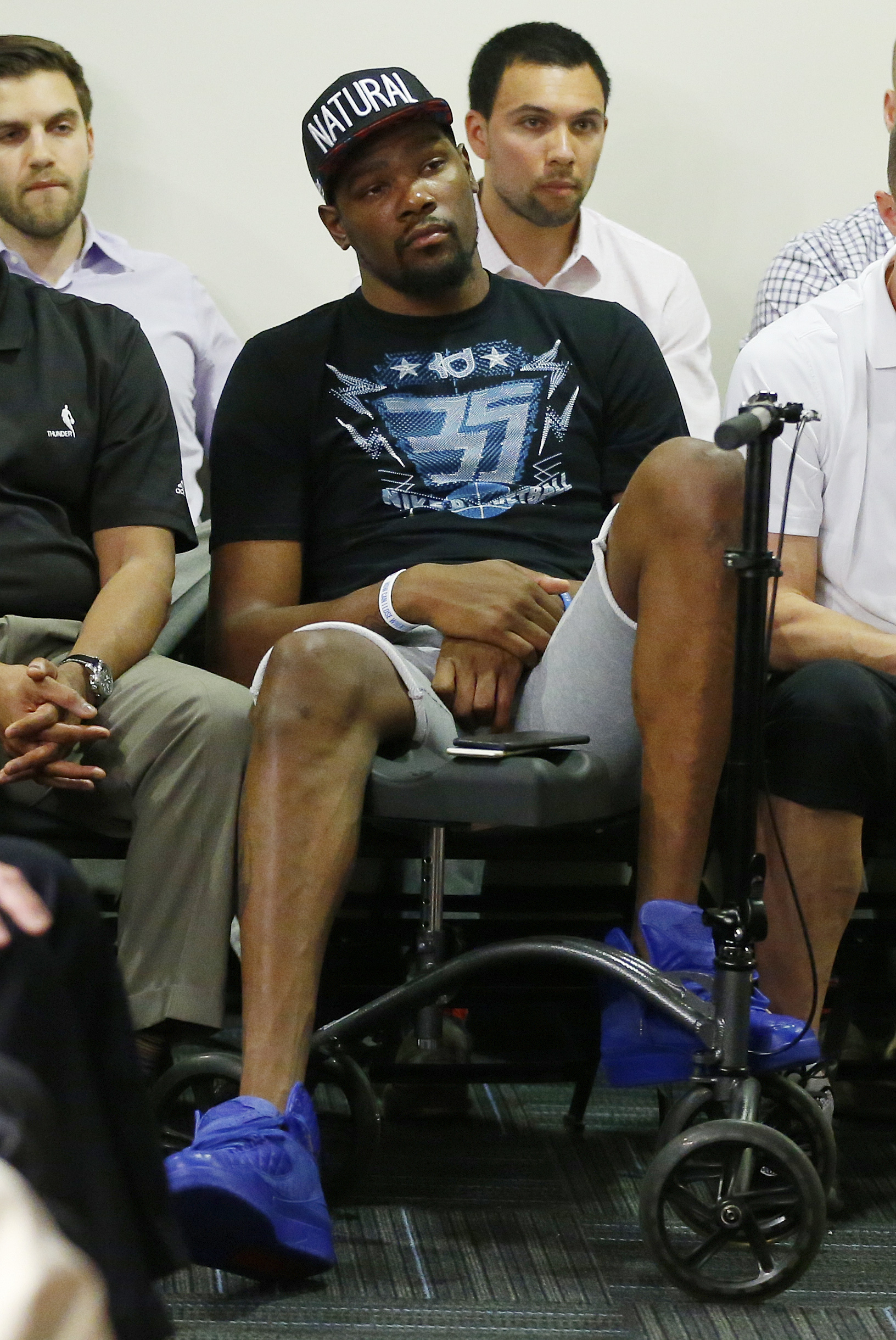 FILE - In  this May 1, 2015, file photo, Oklahoma Thunder's injured forward Kevin Durant watches during a press conference in Oklahoma City. The schedule has been changed to reduce back-to-backs, the union has hired a sports scientist to aid the process a
