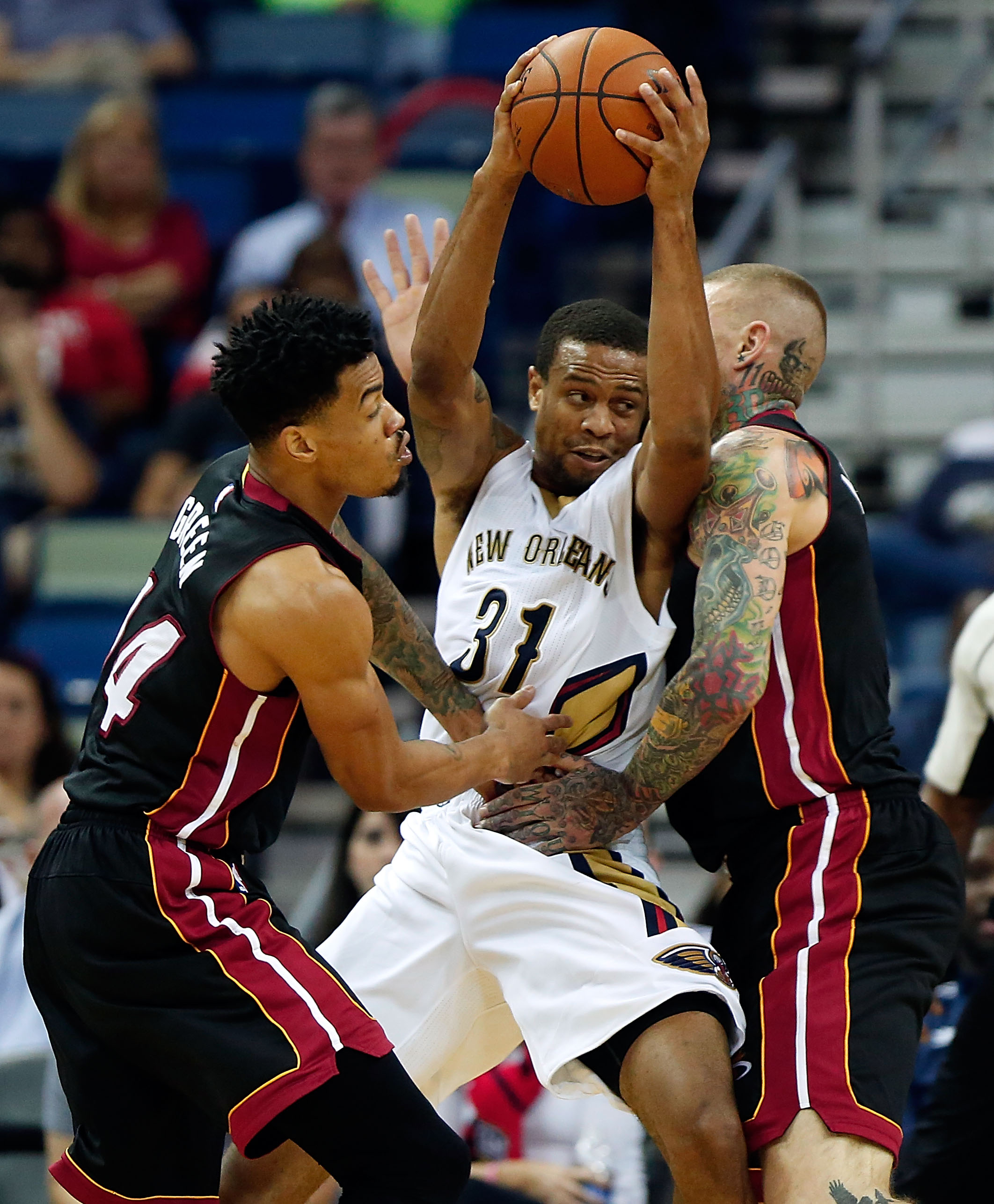 New Orleans Pelicans guard Bryce Dejean-Jones (31) is stopped by Miami Heat forward Chris Andersen, right, and guard Gerald Green, left, during the second half of an NBA preseason basketball game in New Orleans, Friday, Oct 23, 2015. The Pelicans won 93-9