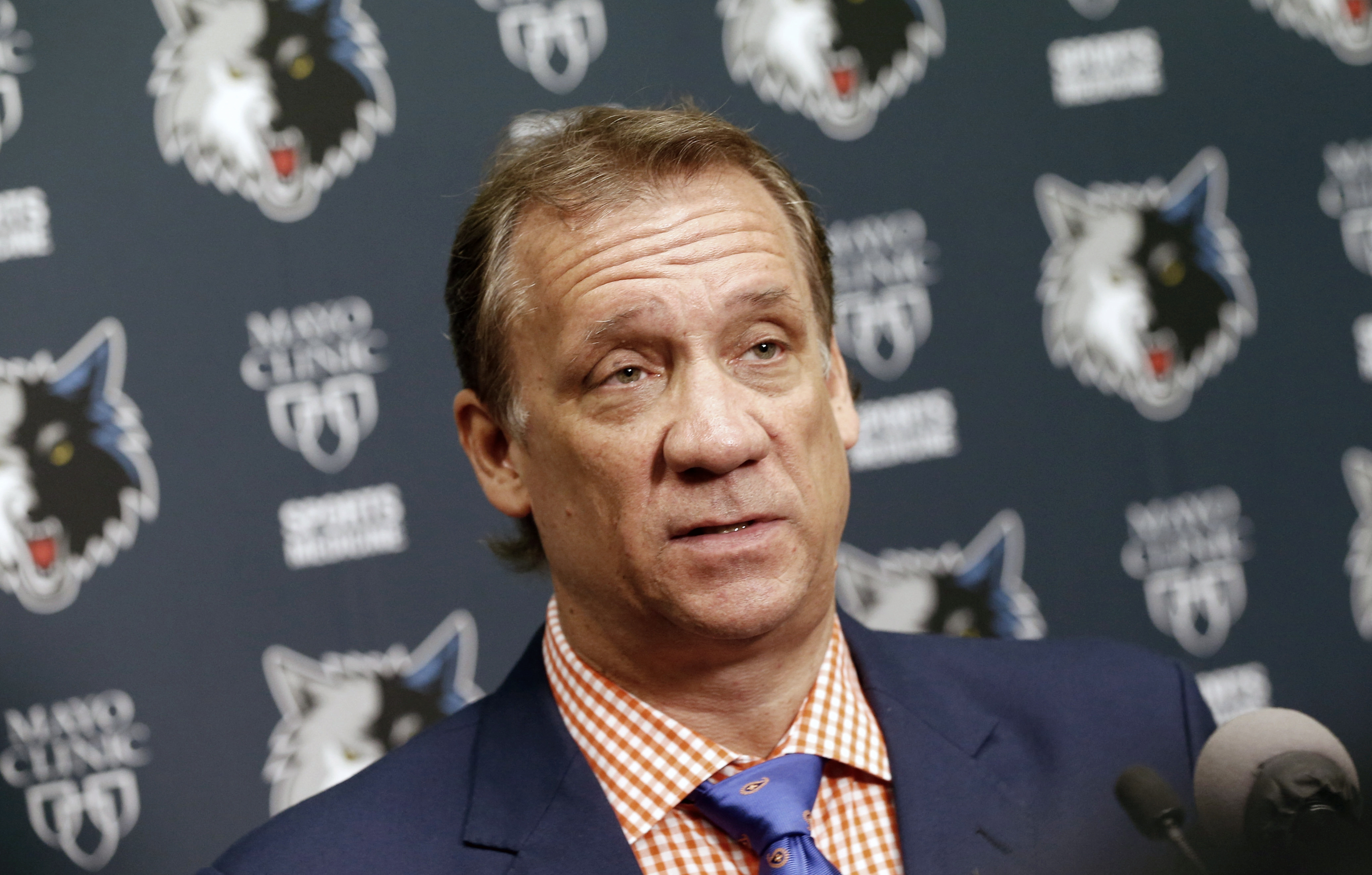 FILE - In this June 25, 2015, file photo, Minnesota Timberwolves president and coach Flip Saunders addresses members of the media during an NBA basketball news conference in Minneapolis. Sam Mitchell will replace Saunders as coach of the Timberwolves in t