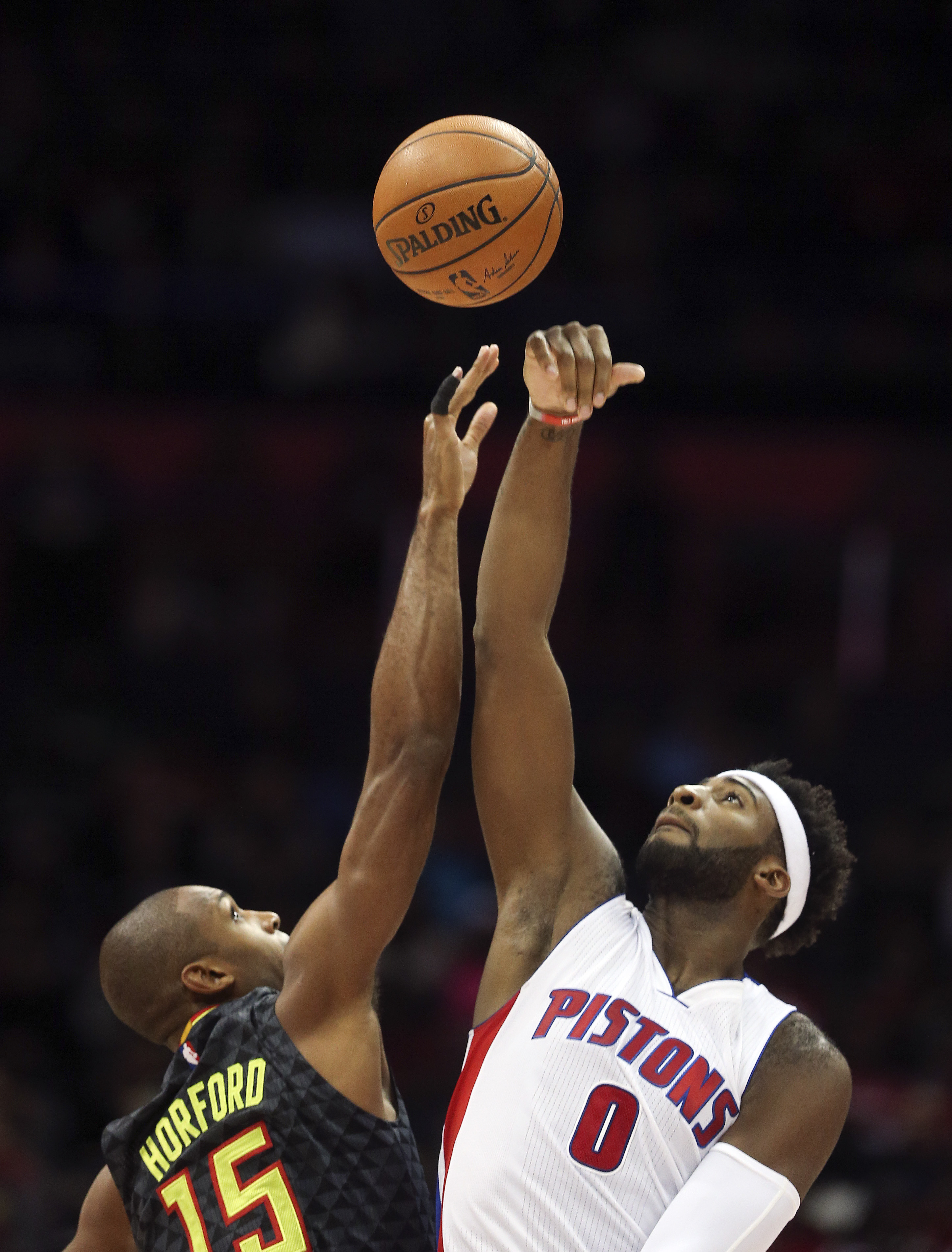 Atlanta Hawks forward Al Horford (15) and Detroit Pistons center Andre Drummond (0) battle for the opening tip during the first half of an NBA basketball game Tuesday, Oct. 27, 2015, in Atlanta. (AP Photo/ John Bazemore)