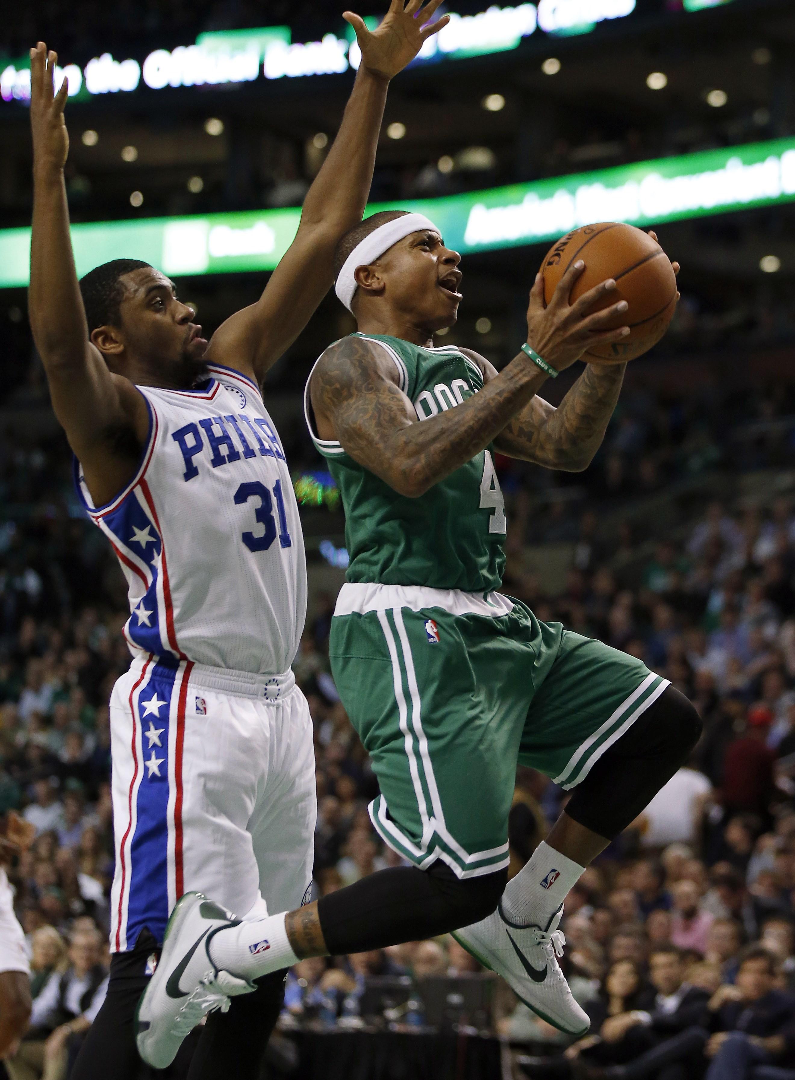 Boston Celtics' Isaiah Thomas (4) drives past Philadelphia 76ers' Hollis Thompson (31) during the second quarter of an NBA basketball game in Boston, Wednesday, Oct. 28, 2015. (AP Photo/Michael Dwyer)