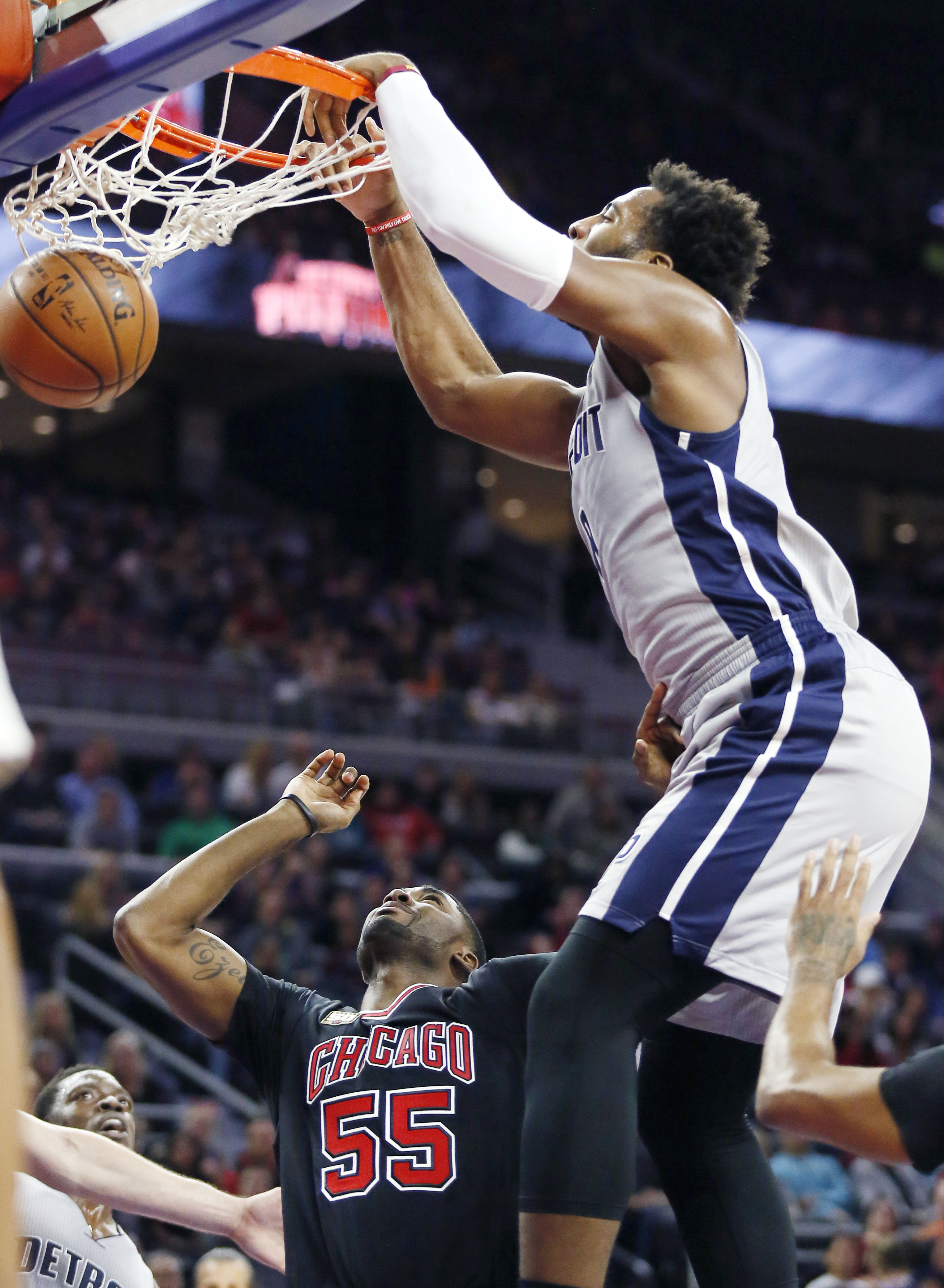 Detroit Pistons' Andre Drummond dunks over Chicago Bulls' E'Twaun Moore (55) during the first half of an NBA basketball game Friday, Oct. 30, 2015, in Auburn Hills, Mich. (AP Photo/Duane Burleson)