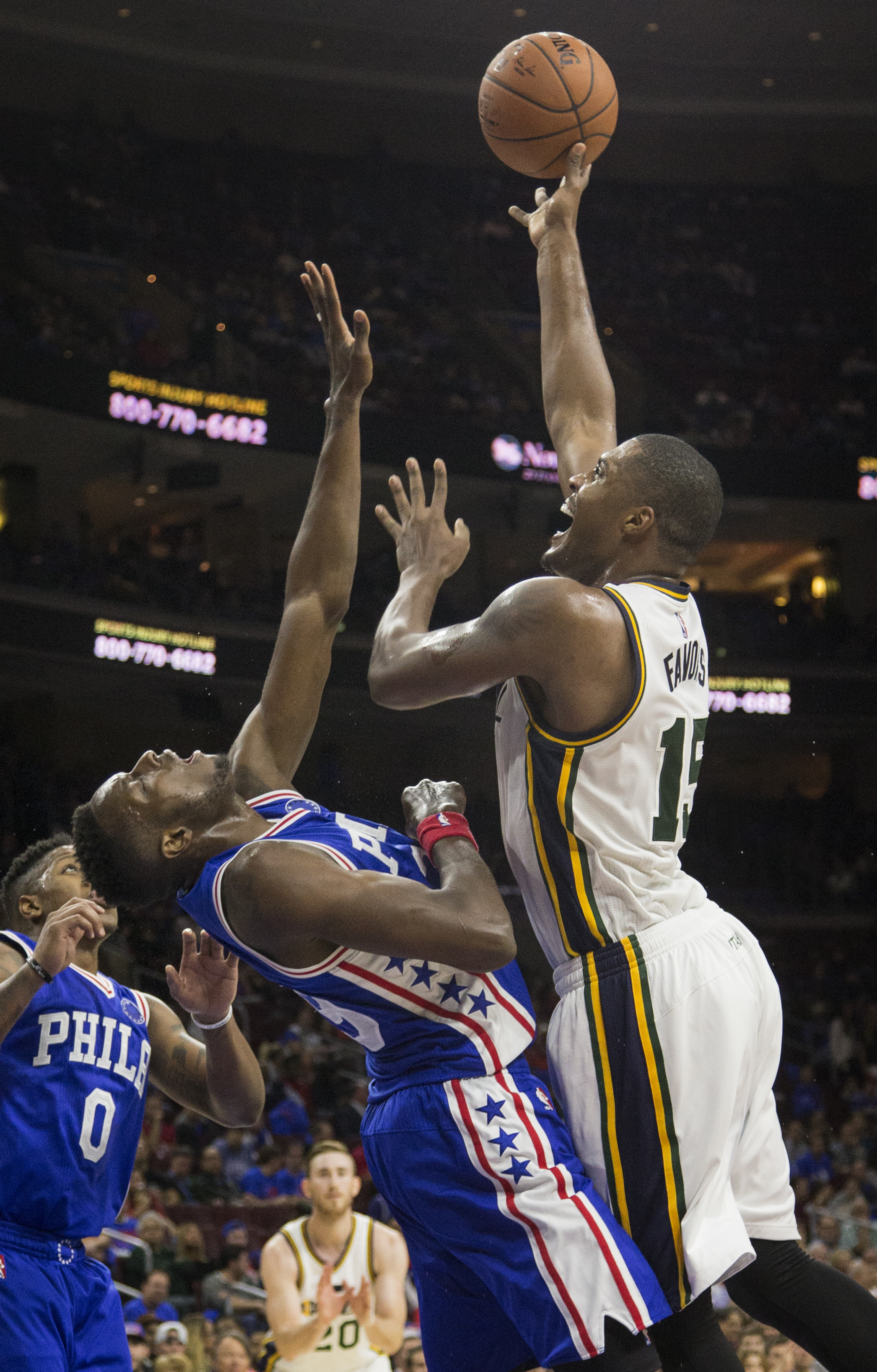 Utah Jazz forward Derrick Favors (15) shots over Philadelphia 76ers' Jerami Grant (39) in the second half of an NBA basketball game, Friday, Oct. 30, 2015, in Philadelphia. The Utah Jazz won 99-71. (AP Photo/Laurence Kesterson)