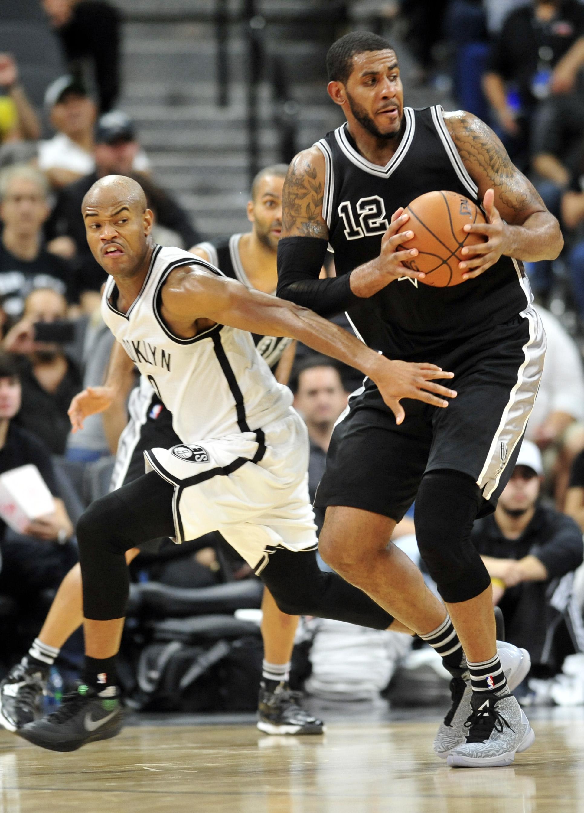 Brooklyn Nets guard Jarrett Jack, left, defends San Antonio Spurs forward LaMarcus Aldridge in the second half of an NBA basketball game Friday, Oct. 30, 2015, in San Antonio. (AP Photo/Bahram Mark Sobhani)