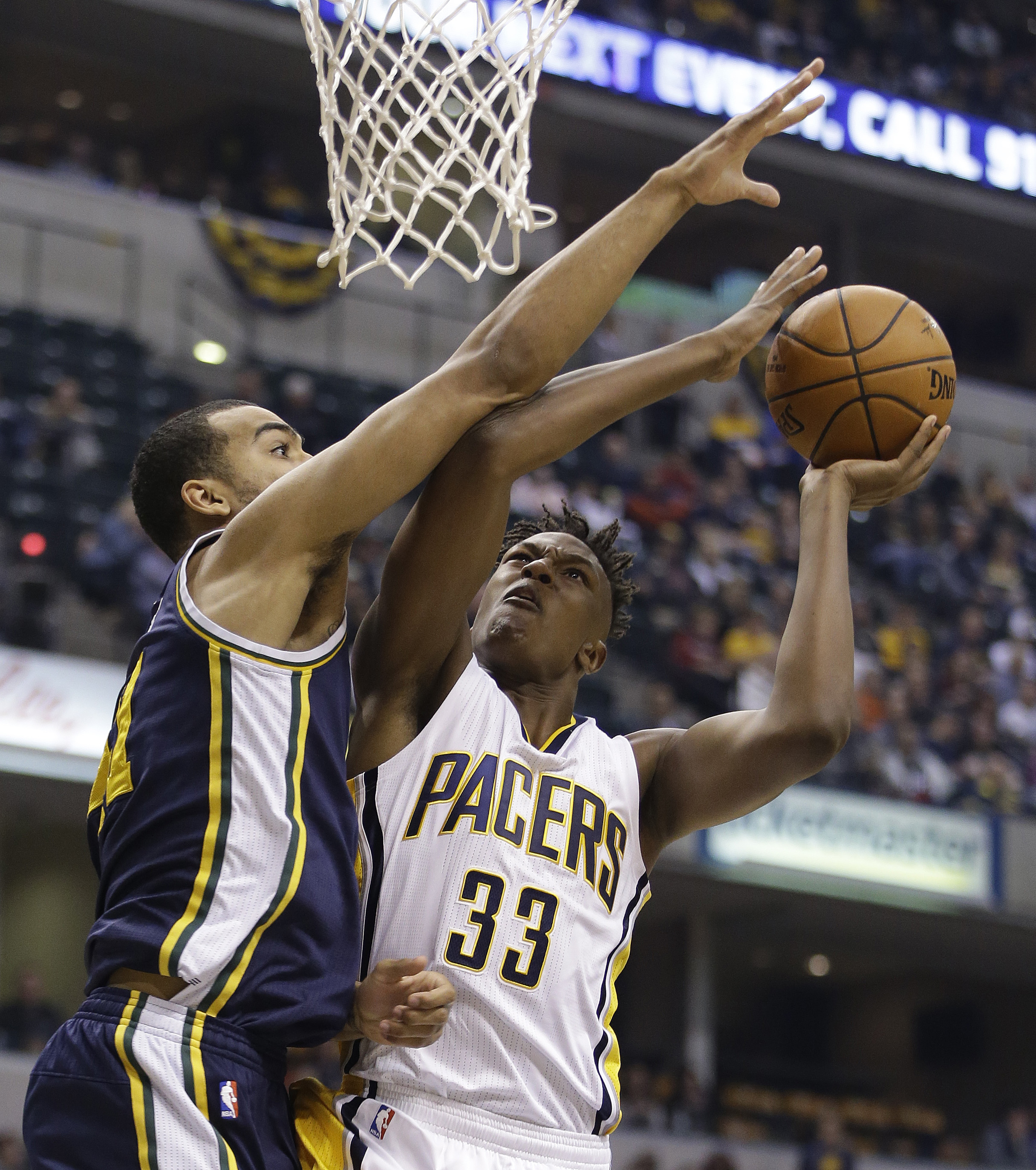 Indiana Pacers' Myles Turner (33) shoots against Utah Jazz's Trey Lyles, left, during the first half of an NBA basketball game Saturday, Oct. 31, 2015, in Indianapolis. (AP Photo/Darron Cummings)