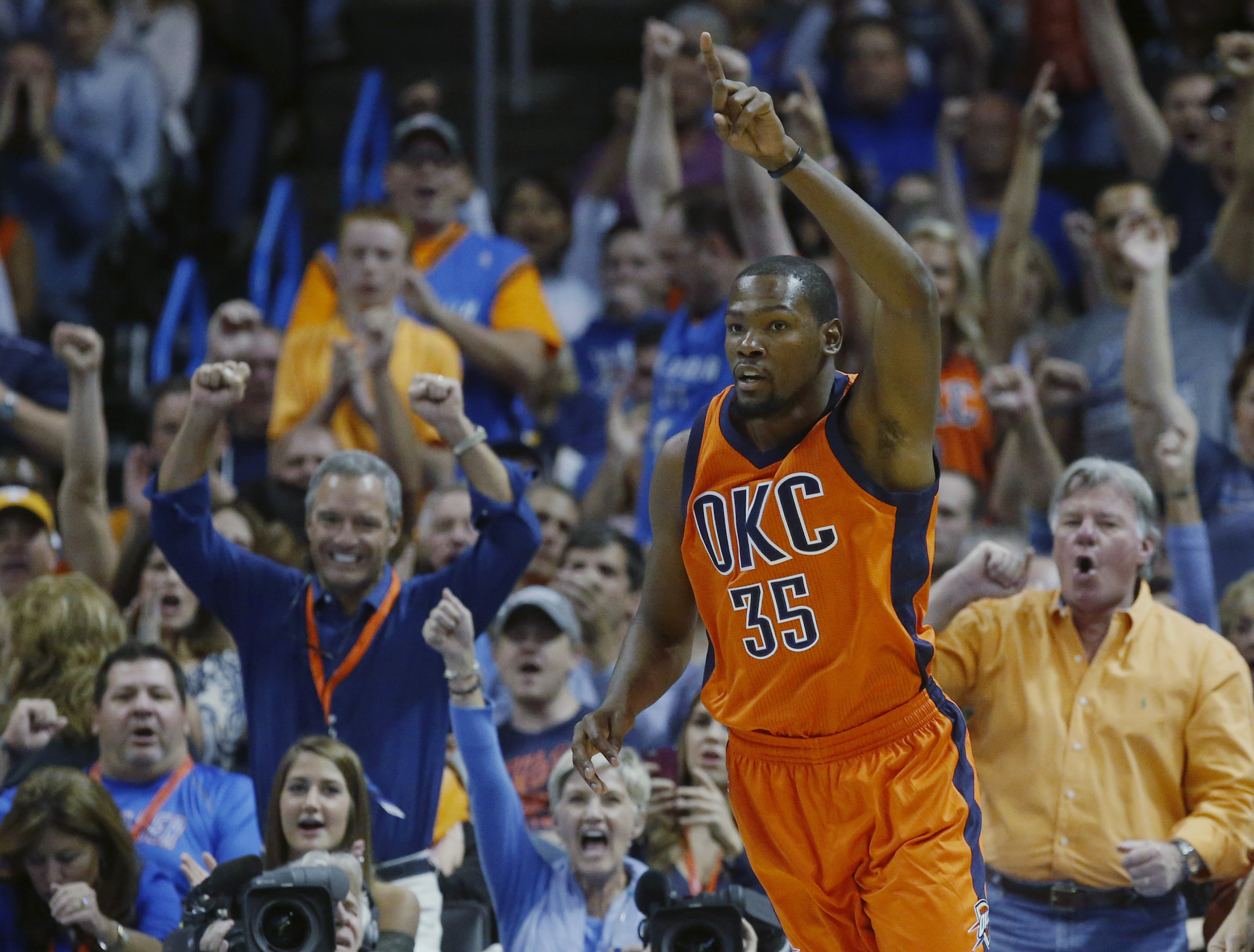 Oklahoma City Thunder forward Kevin Durant (35) celebrates a basket in the first half of an NBA basketball game against the Denver Nuggets in Oklahoma City, Sunday, Nov. 1, 2015. (AP Photo/Sue Ogrocki)