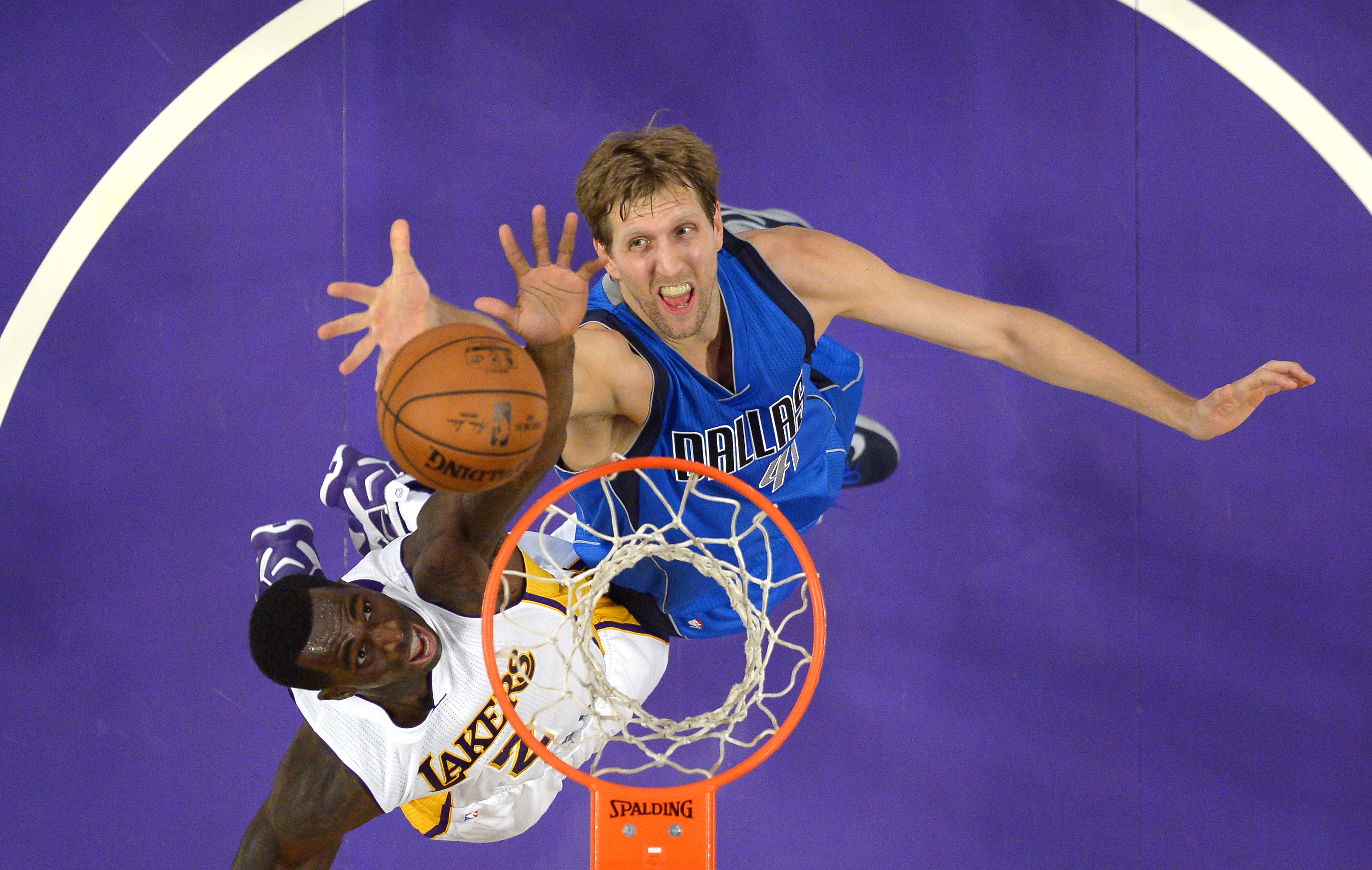 Los Angeles Lakers forward Brandon Bass, left and Dallas Mavericks forward Dirk Nowitzki, of Germany, battle for a rebound during the first half of an NBA basketball game, Sunday, Nov. 1, 2015, in Los Angeles. (AP Photo/Mark J. Terrill)