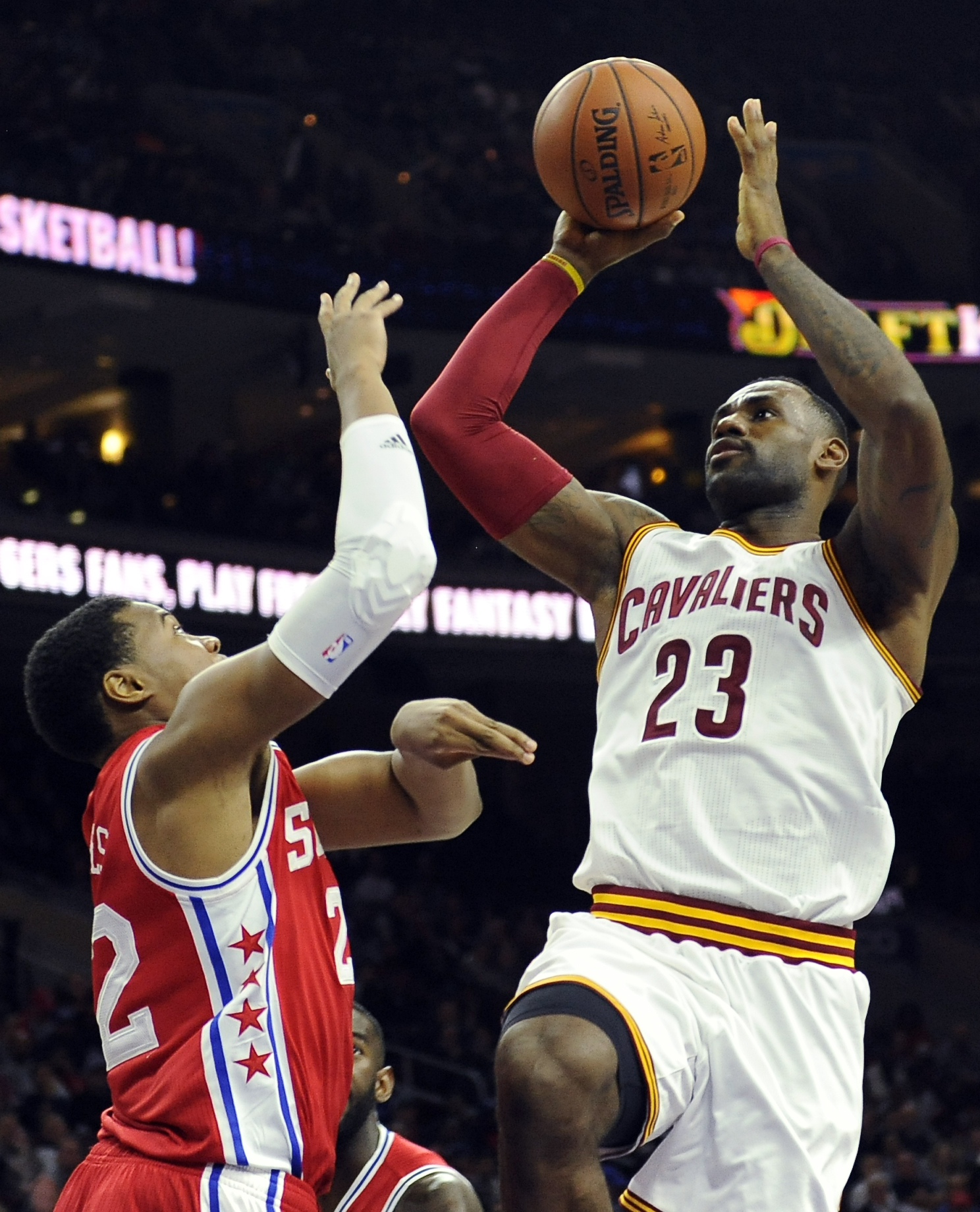 Cleveland Cavaliers' LeBron James (23) shoots over Philadelphia 76ers' Richaun Holmes during the first half of an NBA basketball game Monday, Nov. 2, 2015, in Philadelphia. (AP Photo/Michael Perez)