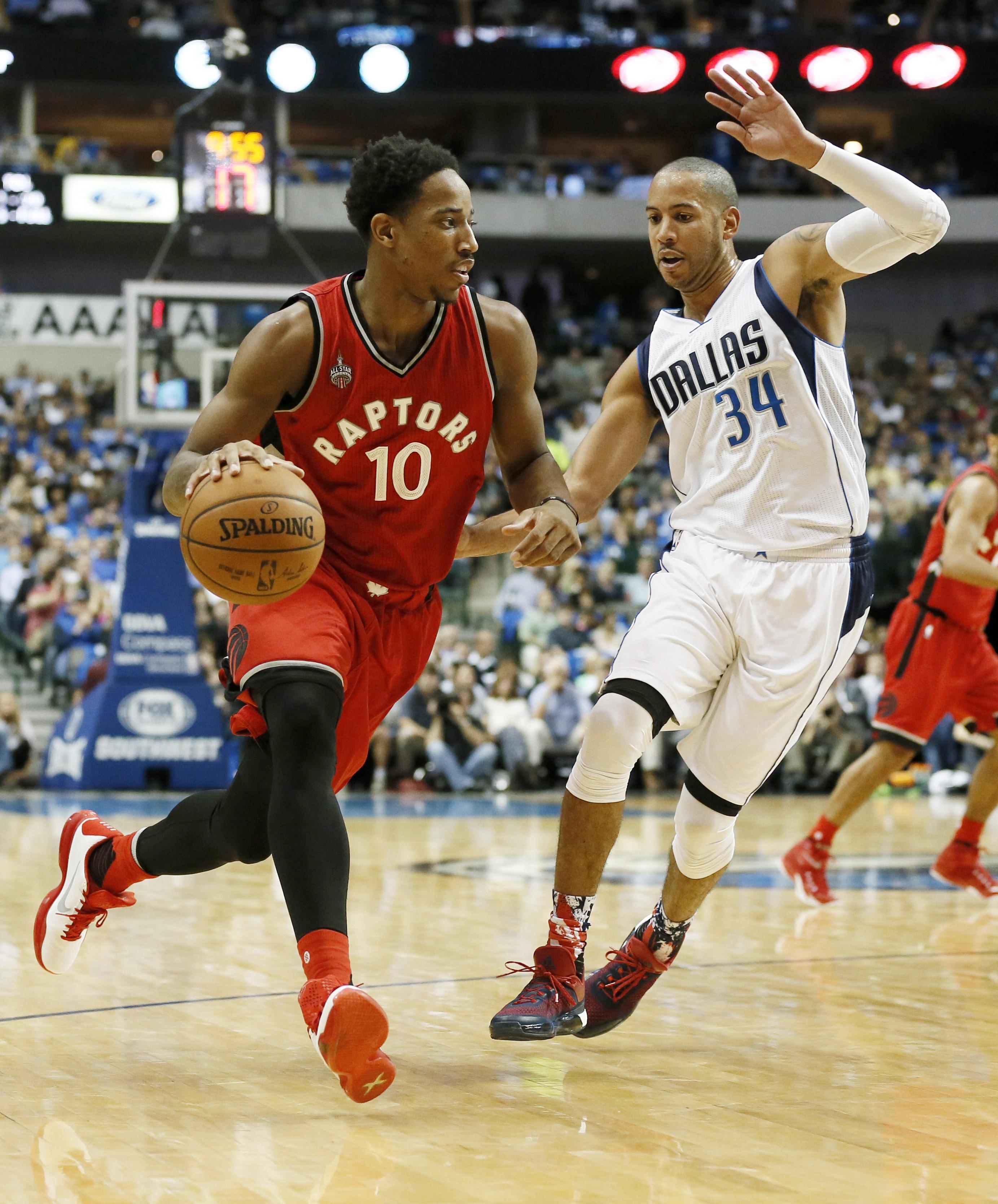 Toronto Raptors' DeMar DeRozan (10) moves the ball up court against Dallas Mavericks' Devin Harris (34) in the first half of an NBA basketball game Tuesday, Nov. 3, 2015, in Dallas.(AP Photo/Tony Gutierrez)