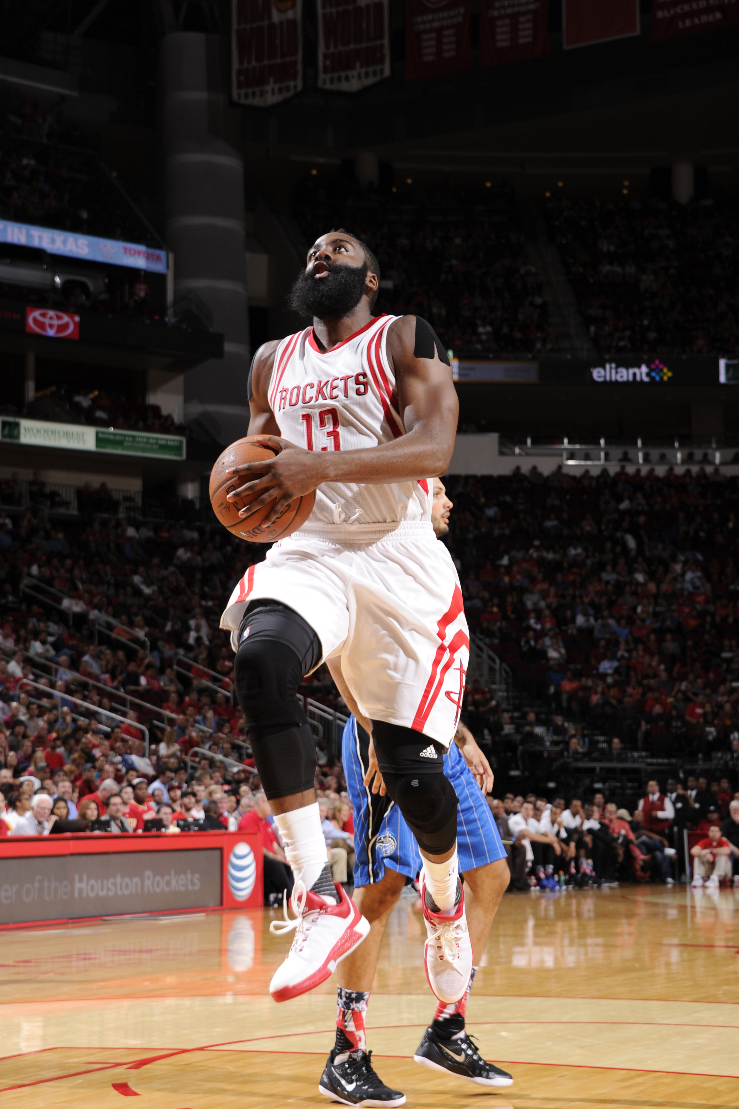 HOUSTON, TX - NOVEMBER 4:  James Harden #13 of the Houston Rockets shoots the ball against the Orlando Magic on November 4, 2015 at the Toyota Center in Houston, Texas. (Photo by Bill Baptist/NBAE via Getty Images)