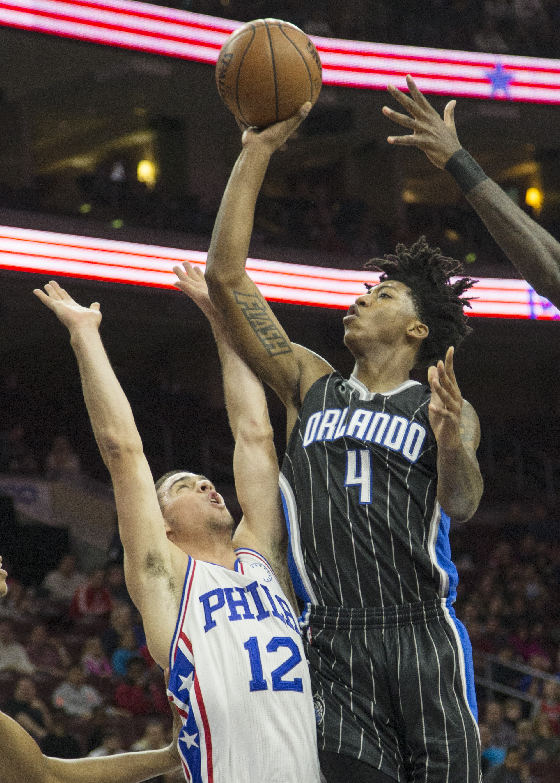 Orlando Magic guard Elfrid Payton (4) shoots over Philadelphia 76ers' T.J. McConnell (12) in the first half of an NBA basketball game, Saturday, Nov. 7, 2015, in Philadelphia. (AP Photo/Laurence Kesterson)