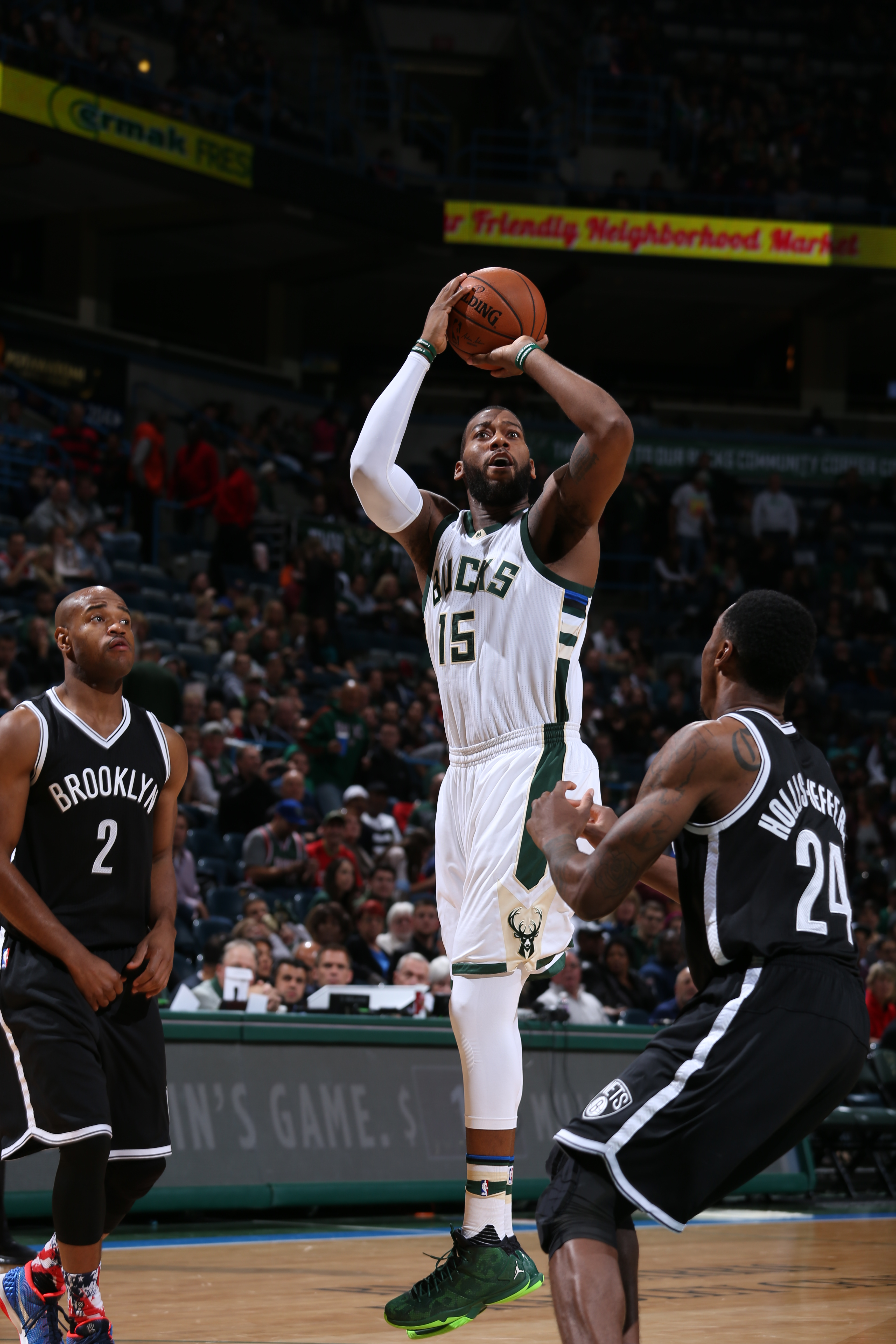 MILWAUKEE, WI - NOVEMBER 7:  Greg Monroe #15 of the Milwaukee Bucks shoots against Rondae Hollis-Jefferson #24 of the Brooklyn Nets on November 7, 2015 at the BMO Harris Bradley Center in Milwaukee, Wisconsin. (Photo by Gary Dineen/NBAE via Getty Images)
