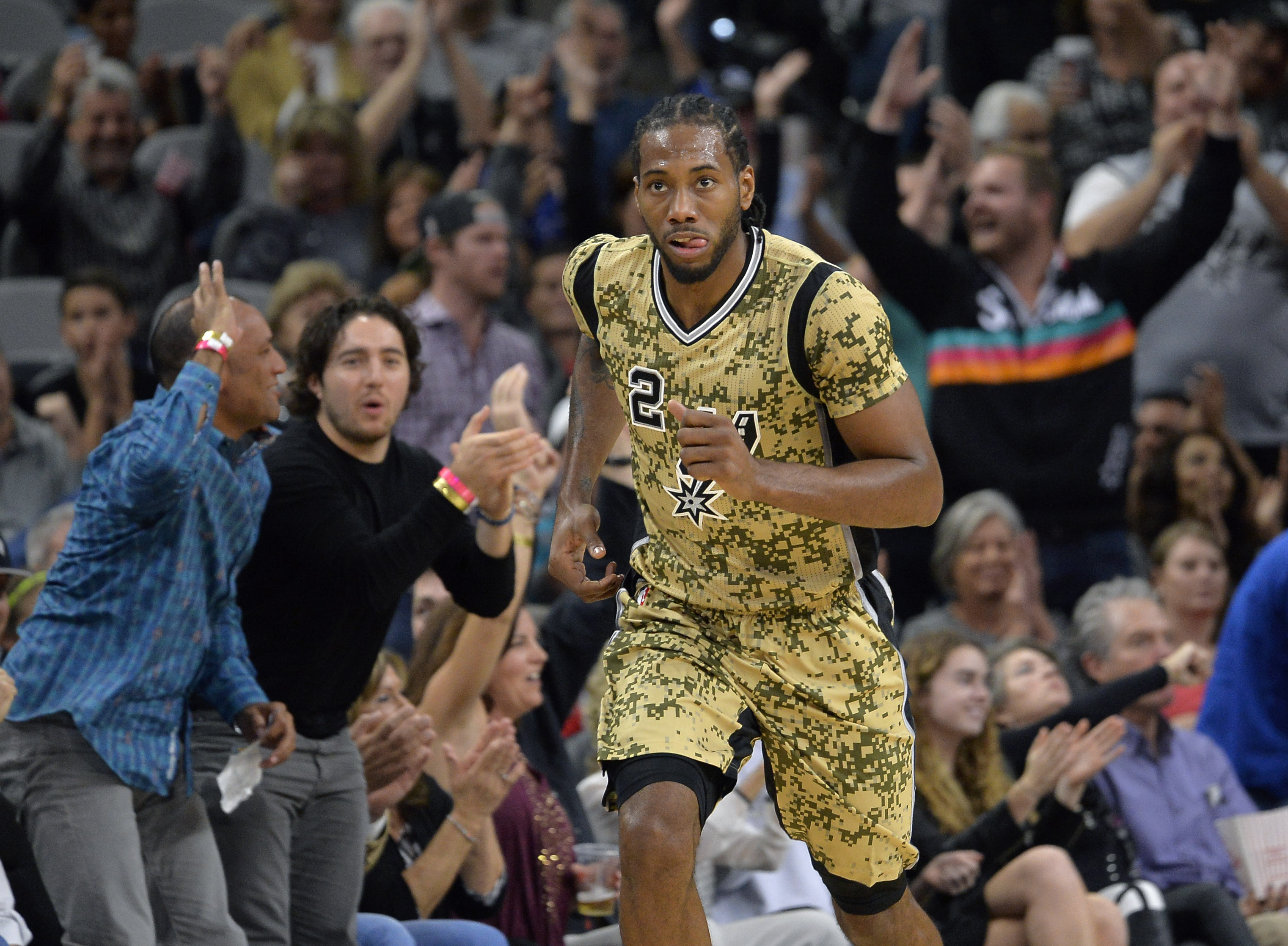 San Antonio Spurs forward Kawhi Leonard runs up court after scoring a basket during the first half of an NBA basketball game against the Charlotte Hornets, Saturday, Nov. 7, 2015, in San Antonio. (AP Photo/Darren Abate)