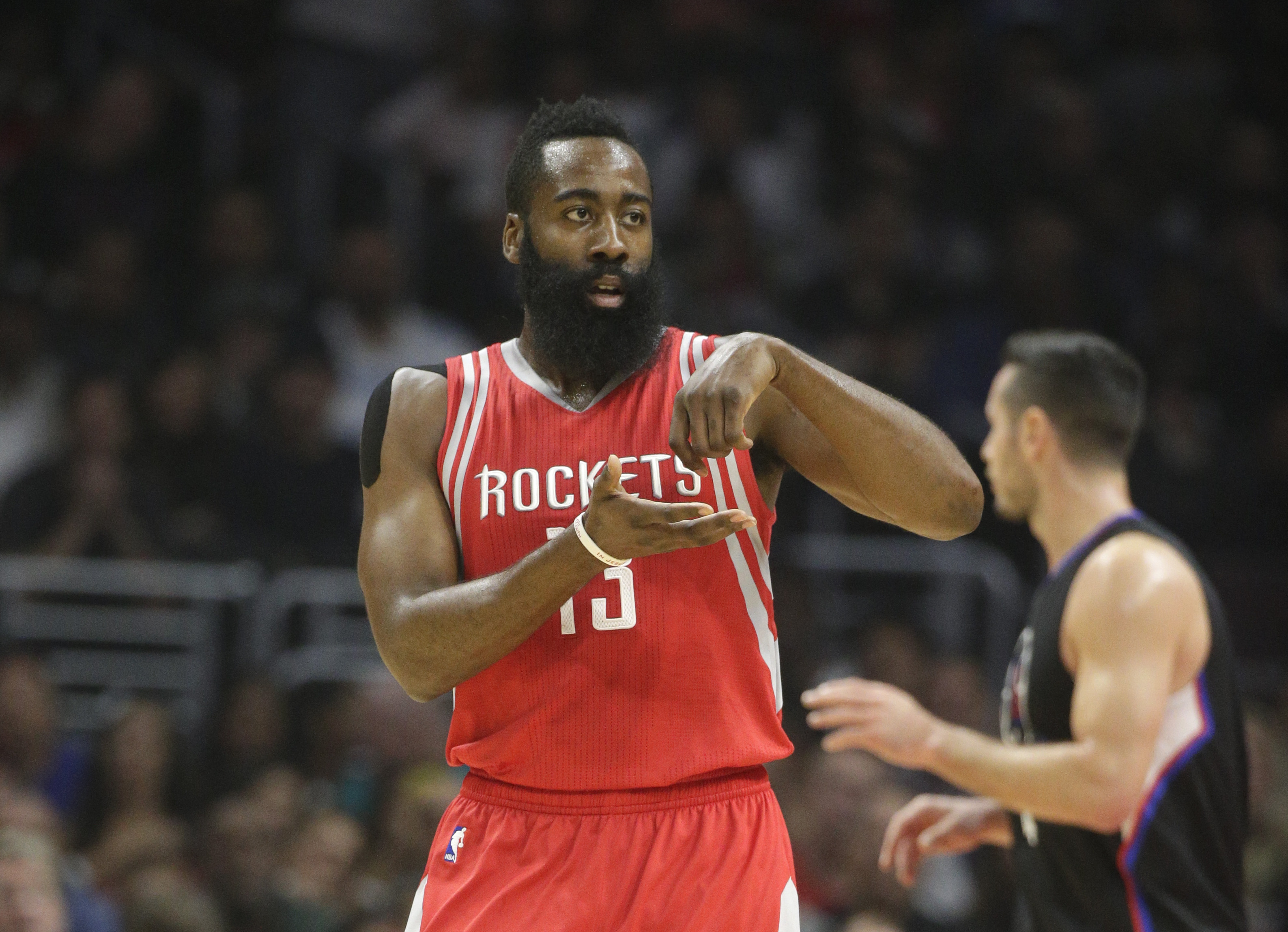 Houston Rockets' James Harden gestures after making a basket during the first half of an NBA basketball game against the Los Angeles Clippers, Saturday, Nov. 7, 2015, in Los Angeles. (AP Photo/Jae C. Hong)