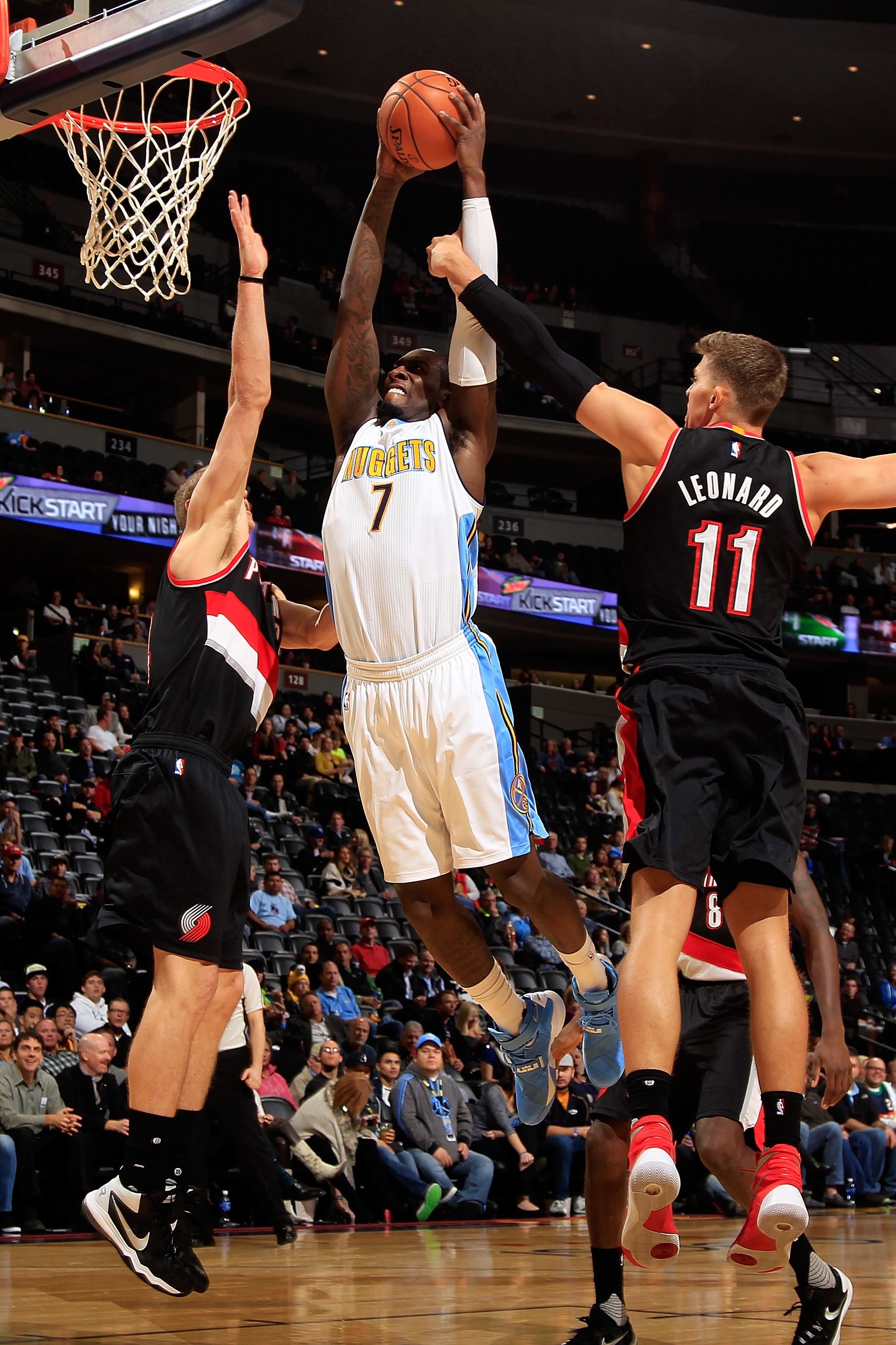 DENVER, CO - NOVEMBER 09:  J.J. Hickson #7 of the Denver Nuggets is fouled by Meyers Leonard #11 of the Portland Trail Blazers as he goes up for a shot at Pepsi Center on November 9, 2015 in Denver, Colorado. The Nuggets defeated the Blazers 108-104. (Pho