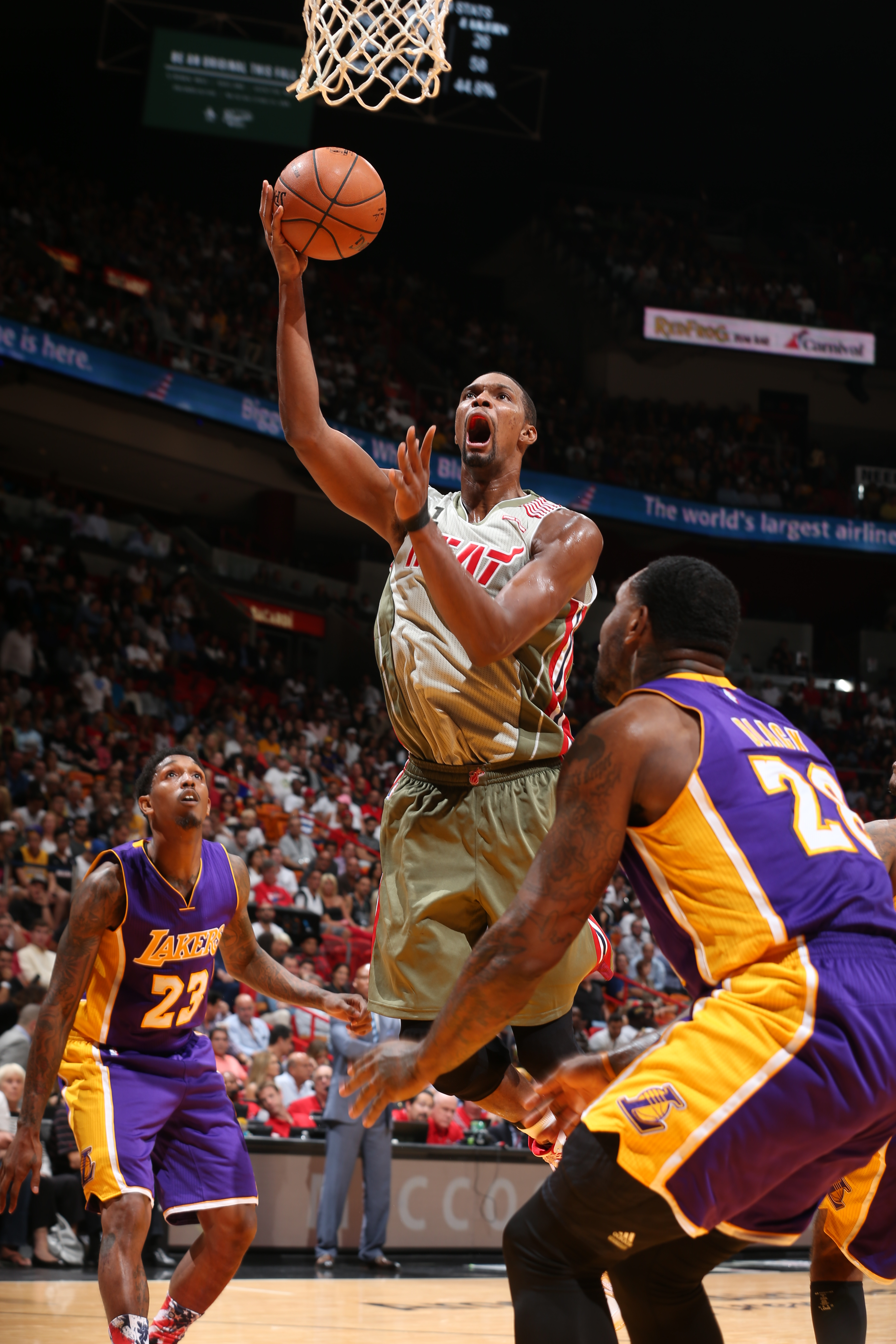 MIAMI, FL - NOVEMBER 10:  Chris Bosh #1 of the Miami Heat goes to the basket against the Los Angeles Lakers on November 10, 2015 at AmericanAirlines Arena in Miami, Florida. (Photo by Joe Murphy/NBAE via Getty Images)