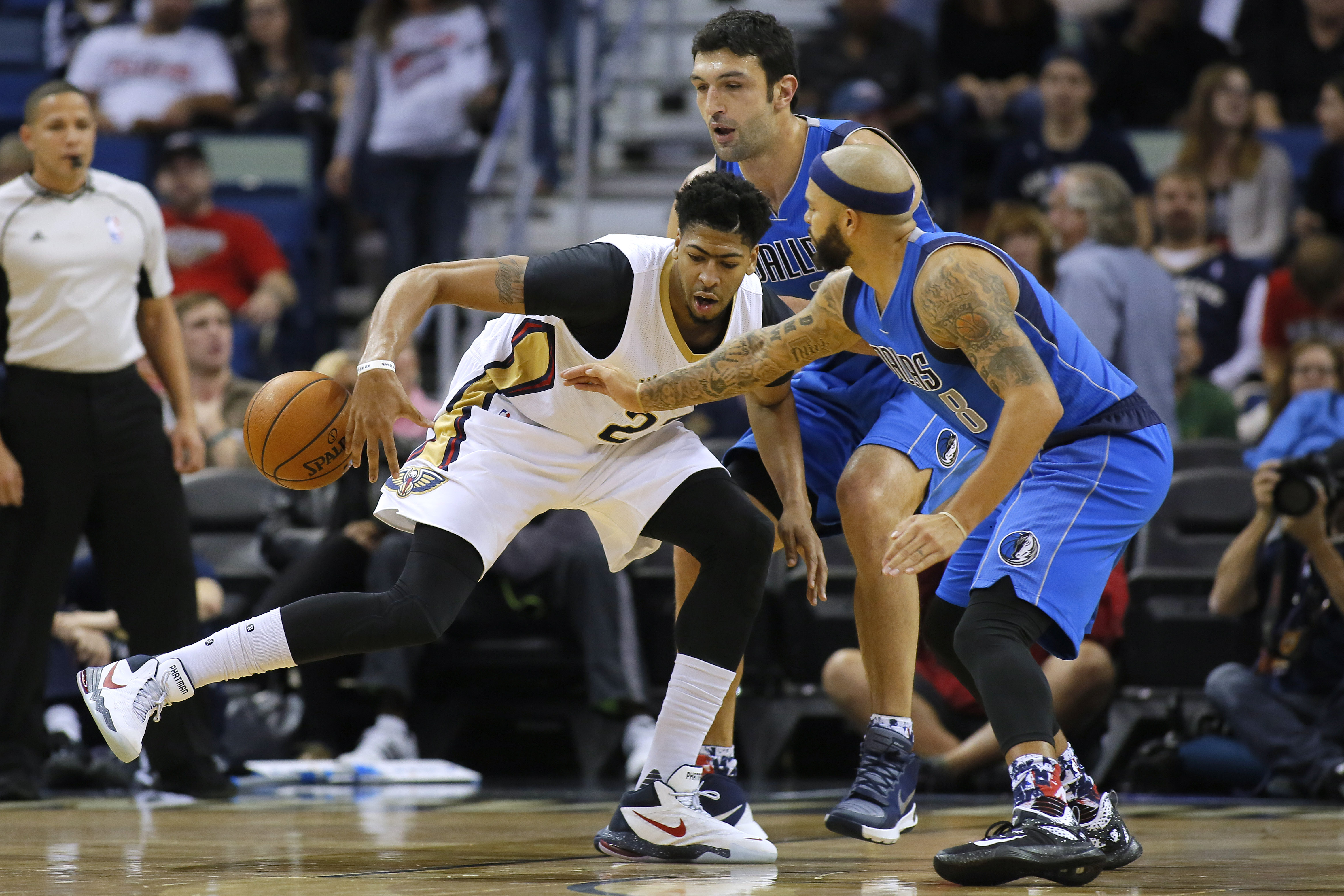 Dallas Mavericks guard Deron Williams (8) strips the ball from New Orleans Pelicans forward Anthony Davis, left, during the first half of an NBA basketball game Tuesday, Nov. 10, 2015, in New Orleans. Davis left the game with a hip injury late in the firs