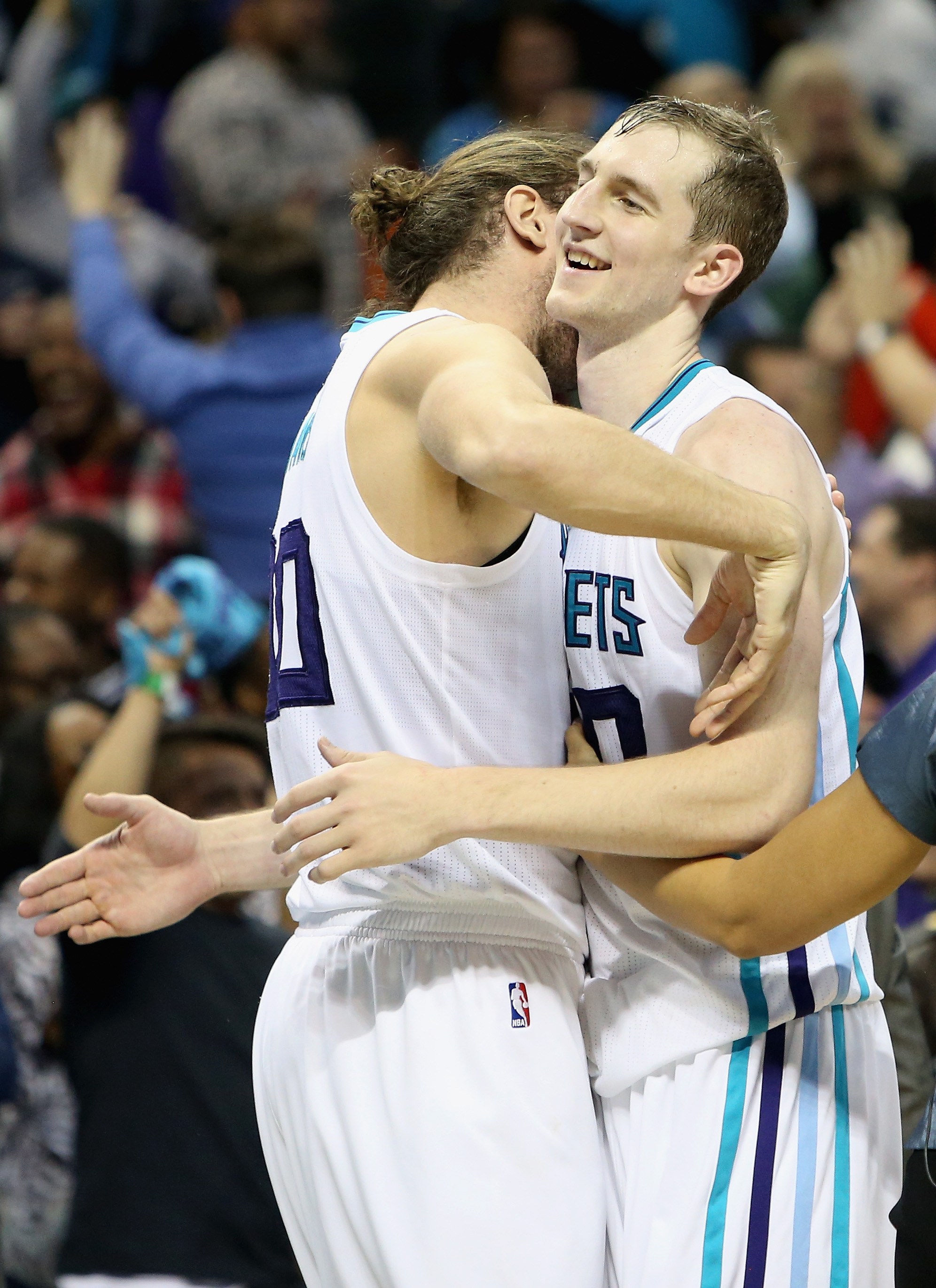 CHARLOTTE, NC - NOVEMBER 11:  Cody Zeller #40 celebrates with teammate Spencer Hawes #00 of the Charlotte Hornets after hitting the game winning shot to defeat the New York Knicks 95-93 during their game at Time Warner Cable Arena on November 11, 2015 in