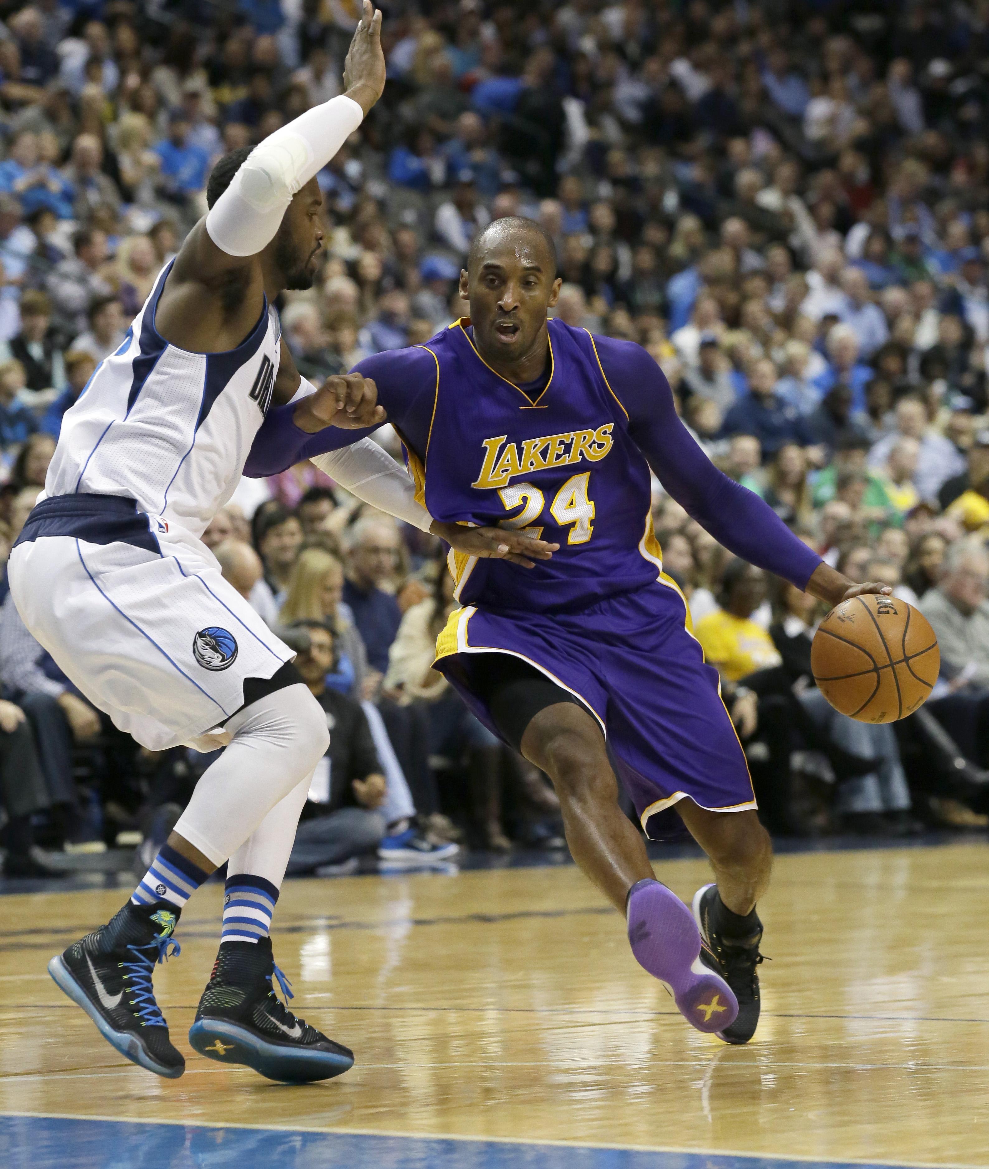 Los Angeles Lakers forward Kobe Bryant (24) drives against Dallas Mavericks guard Raymond Felton (2) during the first half of an NBA basketball game Friday, Nov. 13, 2015, in Dallas. (AP Photo/LM Otero)