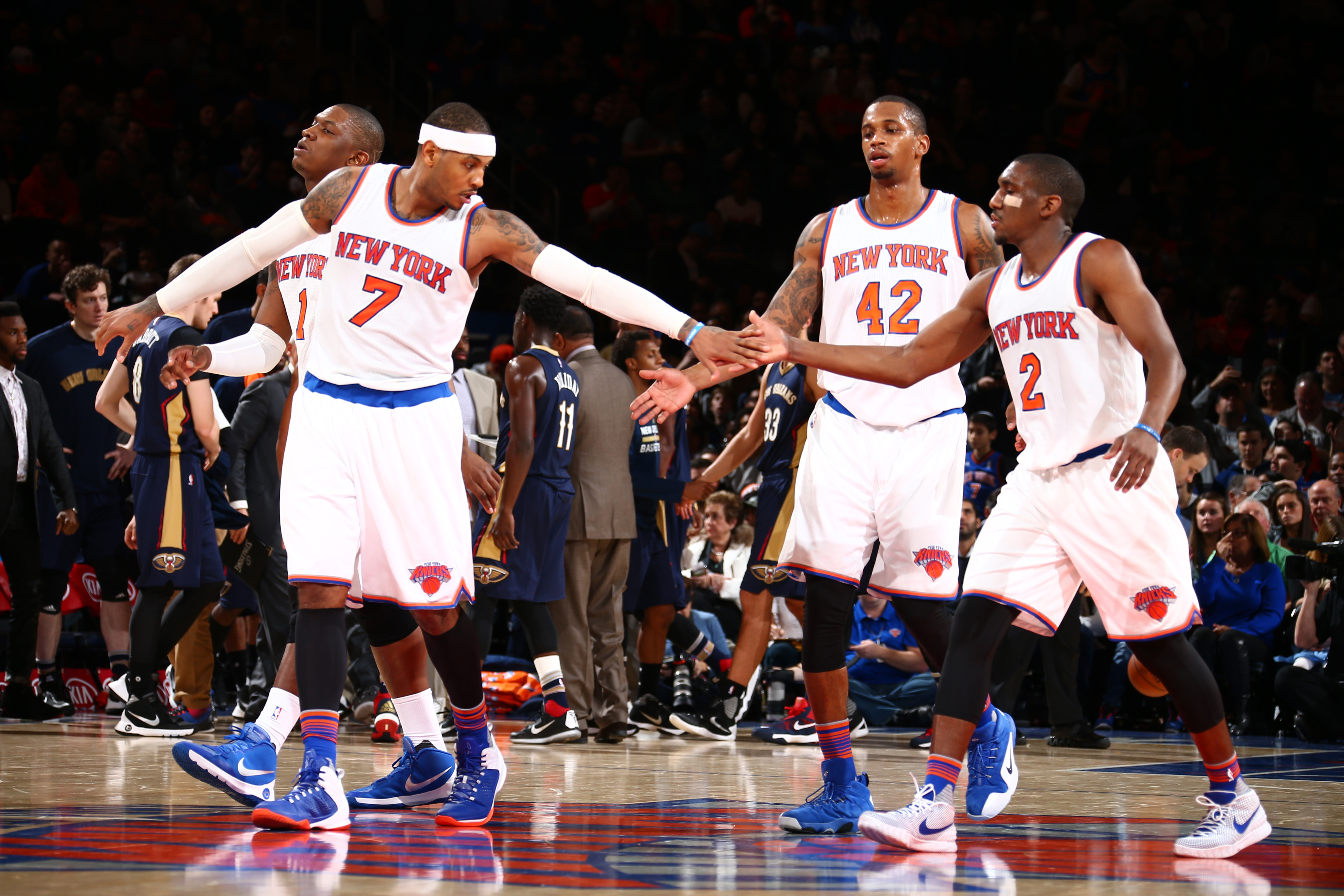 NEW YORK, NY - NOVEMBER 15: Carmelo Anthony #7 high fives teammate Langston Galloway #2 of the New York Knicks during the game on November 15, 2015 at Madison Square Garden in New York, New York. (Photo by Nathaniel S. Butler/NBAE via Getty Images)
