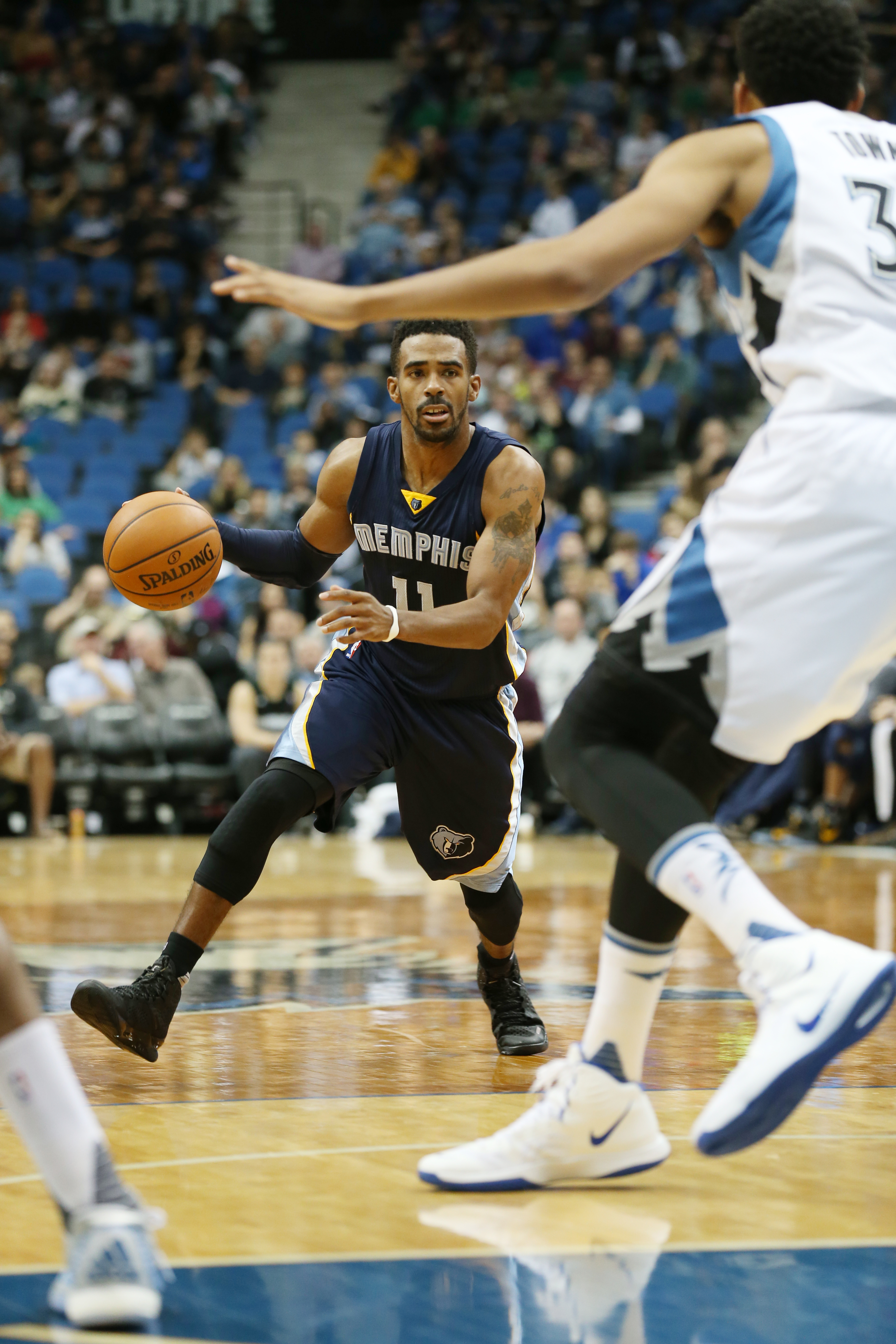MINNEAPOLIS, MN - NOVEMBER 15: Mike Conley #11 of the Memphis Grizzlies looks to move the ball against the Minnesota Timberwolves during the game on November 15, 2015 at Target Center in Minneapolis, Minnesota. (Photo by Jordan Johnson/NBAE via Getty Imag