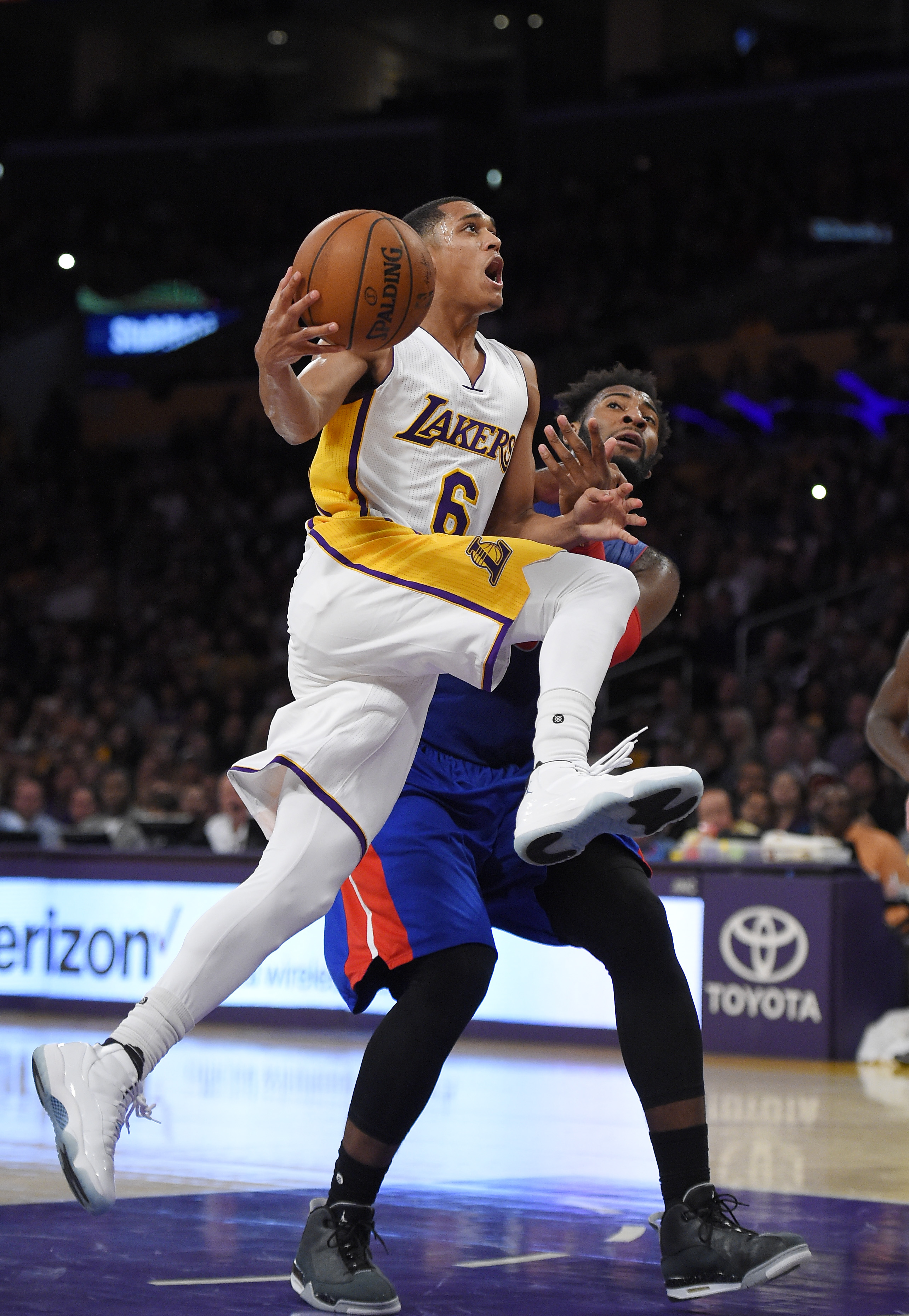 Los Angeles Lakers guard Jordan Clarkson, left, goes up for a shot as Detroit Pistons center Andre Drummond defends during the second half of an NBA basketball game, Sunday, Nov. 15, 2015, in Los Angeles.  The Lakers won 97-85. (AP Photo/Mark J. Terrill)