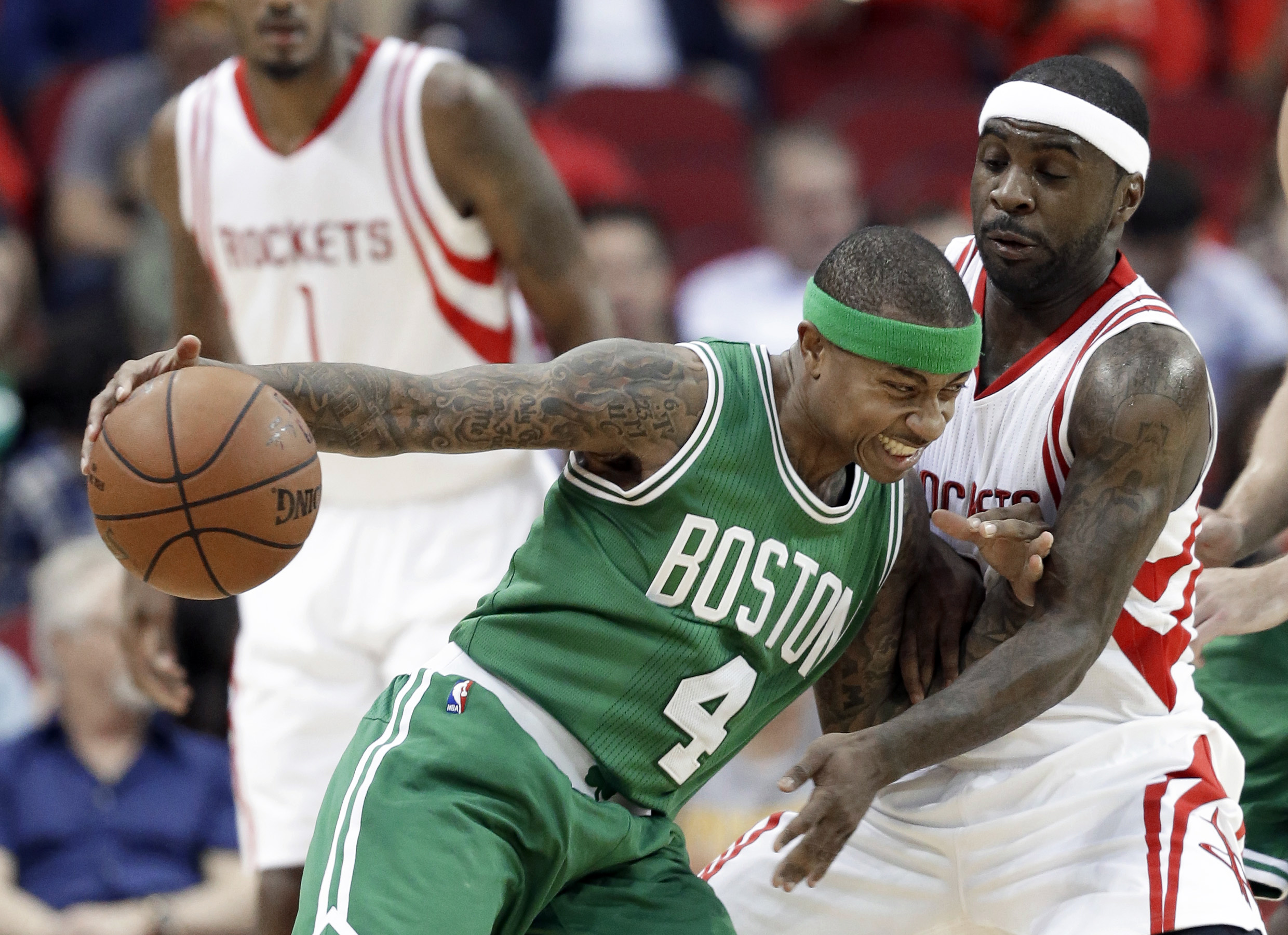 Boston Celtics' Isaiah Thomas (4) pushes against Houston Rockets' Ty Lawson during the first half of an NBA basketball game, Monday, Nov. 16, 2015, in Houston. (AP Photo/Pat Sullivan)