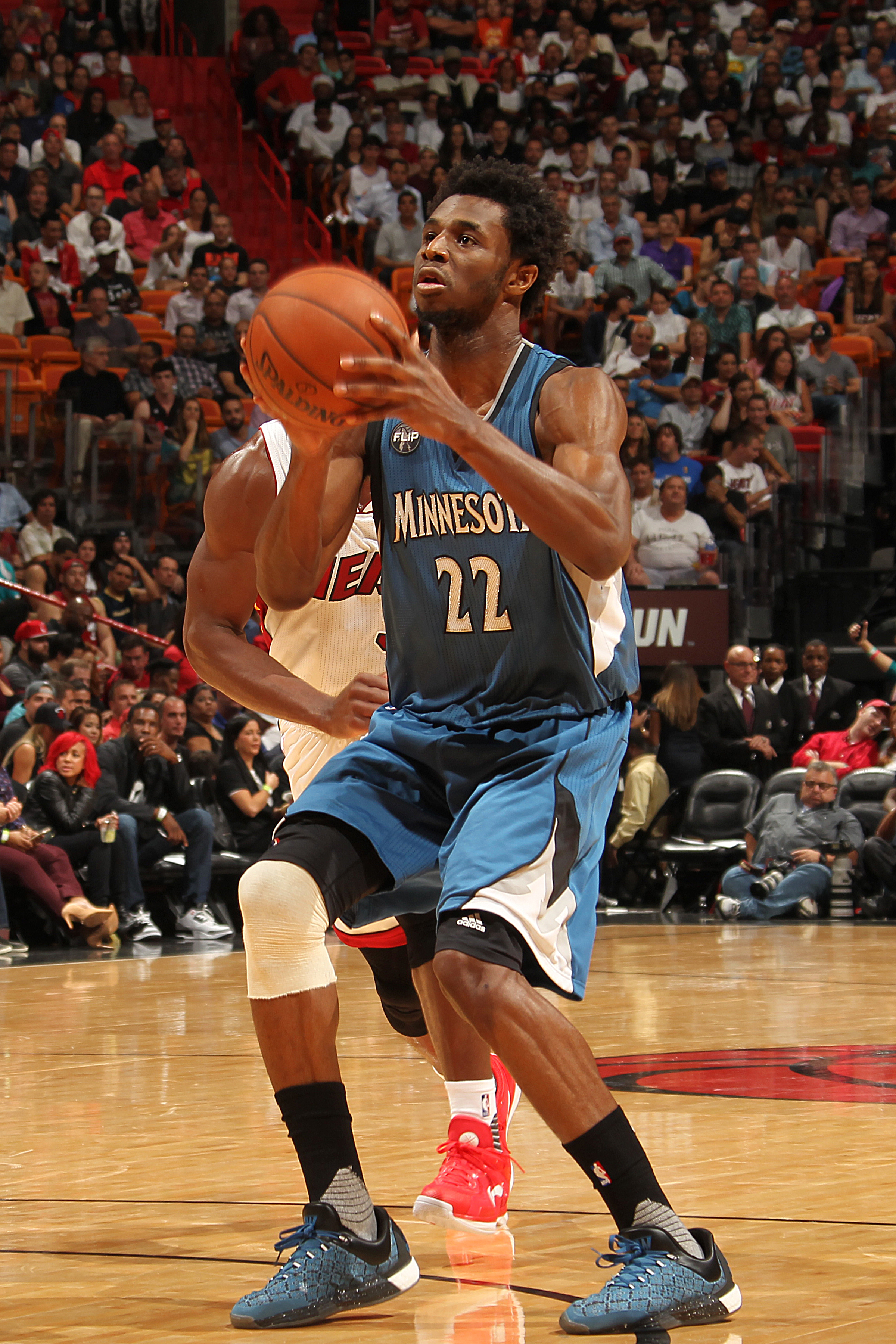MIAMI, FL - NOVEMBER 17:  Andrew Wiggins #22 of the Minnesota Timberwolves shoots the ball against the Miami Heat on November 17, 2015 at American Airlines Arena in Miami, Florida. (Photo by Issac Baldizon/NBAE via Getty Images)