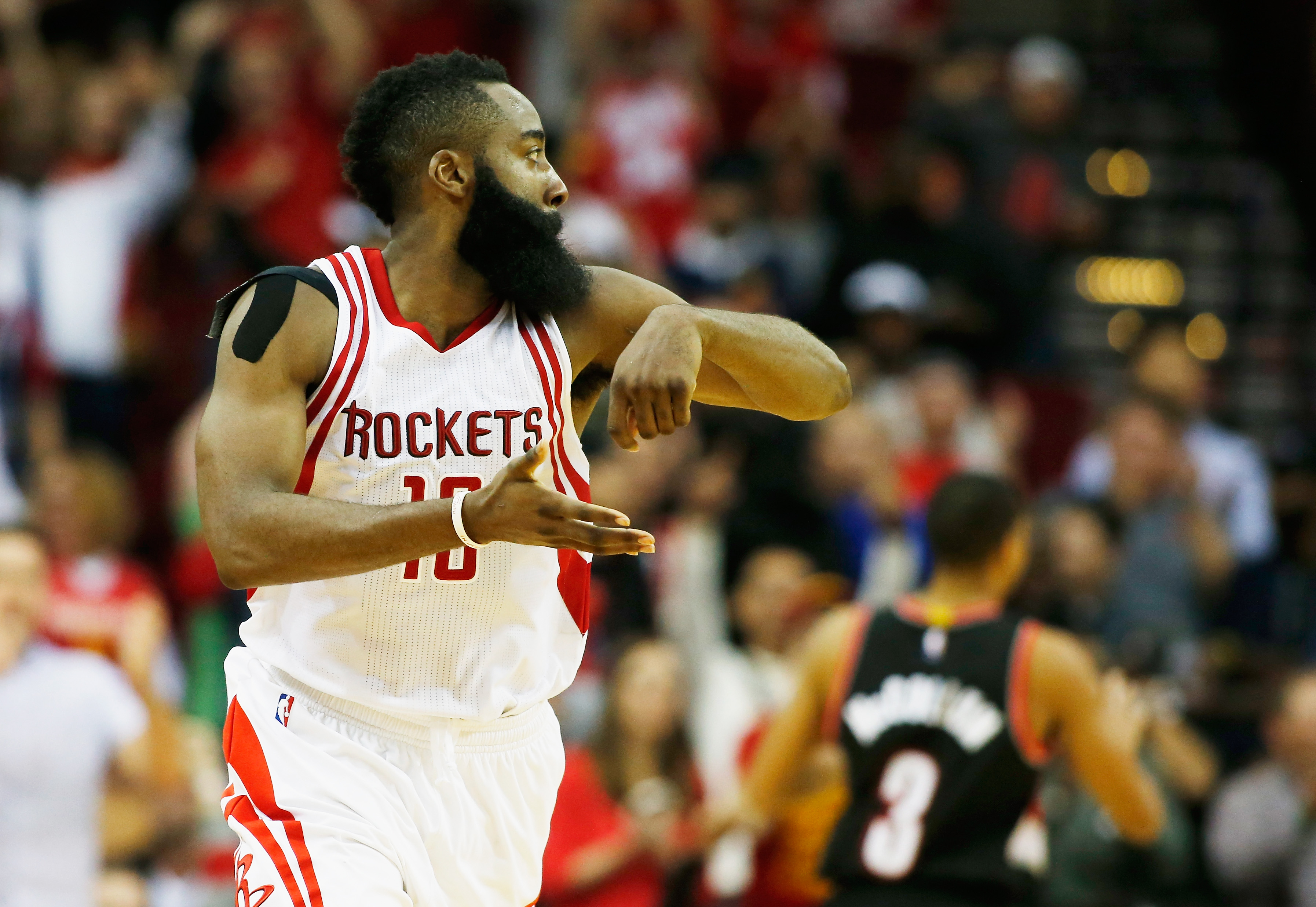 HOUSTON, TX - NOVEMBER 18:  James Harden #13 of the Houston Rockets celebrates after he hit a three-point shot near the end of the fourth quarter against the Portland Trail Blazers during their game at the Toyota Center on November 18, 2015 in Houston, Te