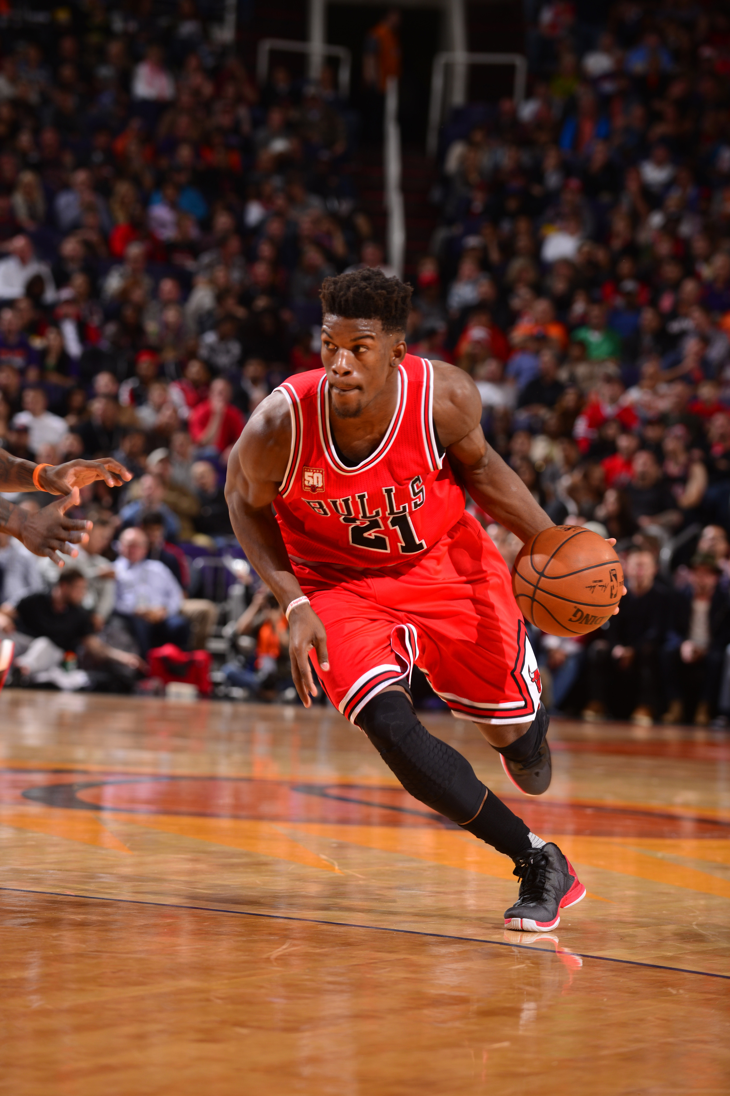 PHOENIX, AZ - NOVEMBER 18:  Jimmy Butler #21 of the Chicago Bulls handles the ball against the Phoenix Suns on November 18, 2015 at Talking Stick Resort Arena in Phoenix, Arizona. (Photo by Barry Gossage/NBAE via Getty Images)