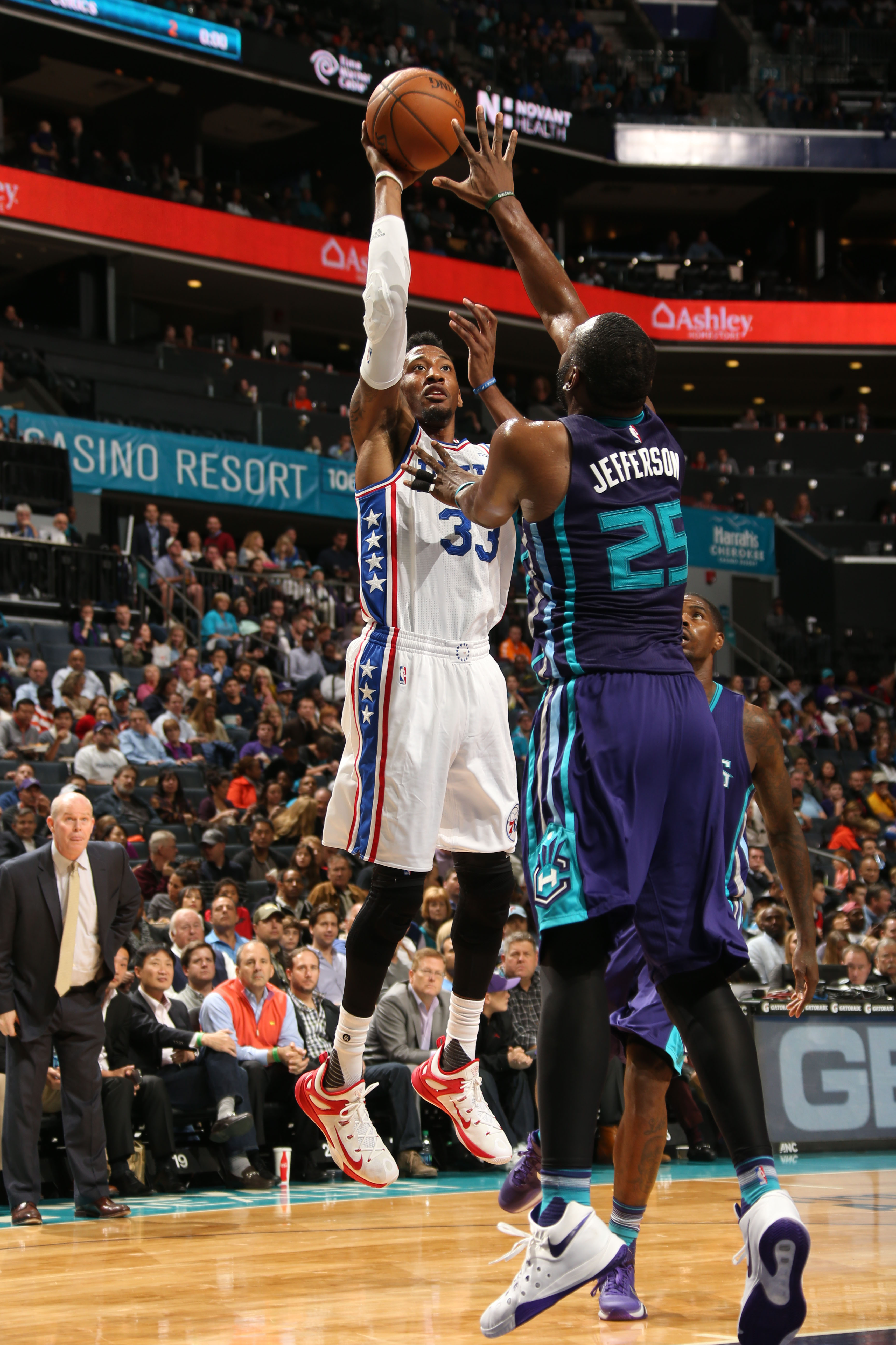 CHARLOTTE, NC - NOVEMBER 20:  Robert Covington #33 of the Philadelphia 76ers shoots against Al Jefferson #25 of the Charlotte Hornets during the game at the Time Warner Cable Arena on November 20, 2015 in Charlotte, North Carolina. (Photo by Kent Smith/NB