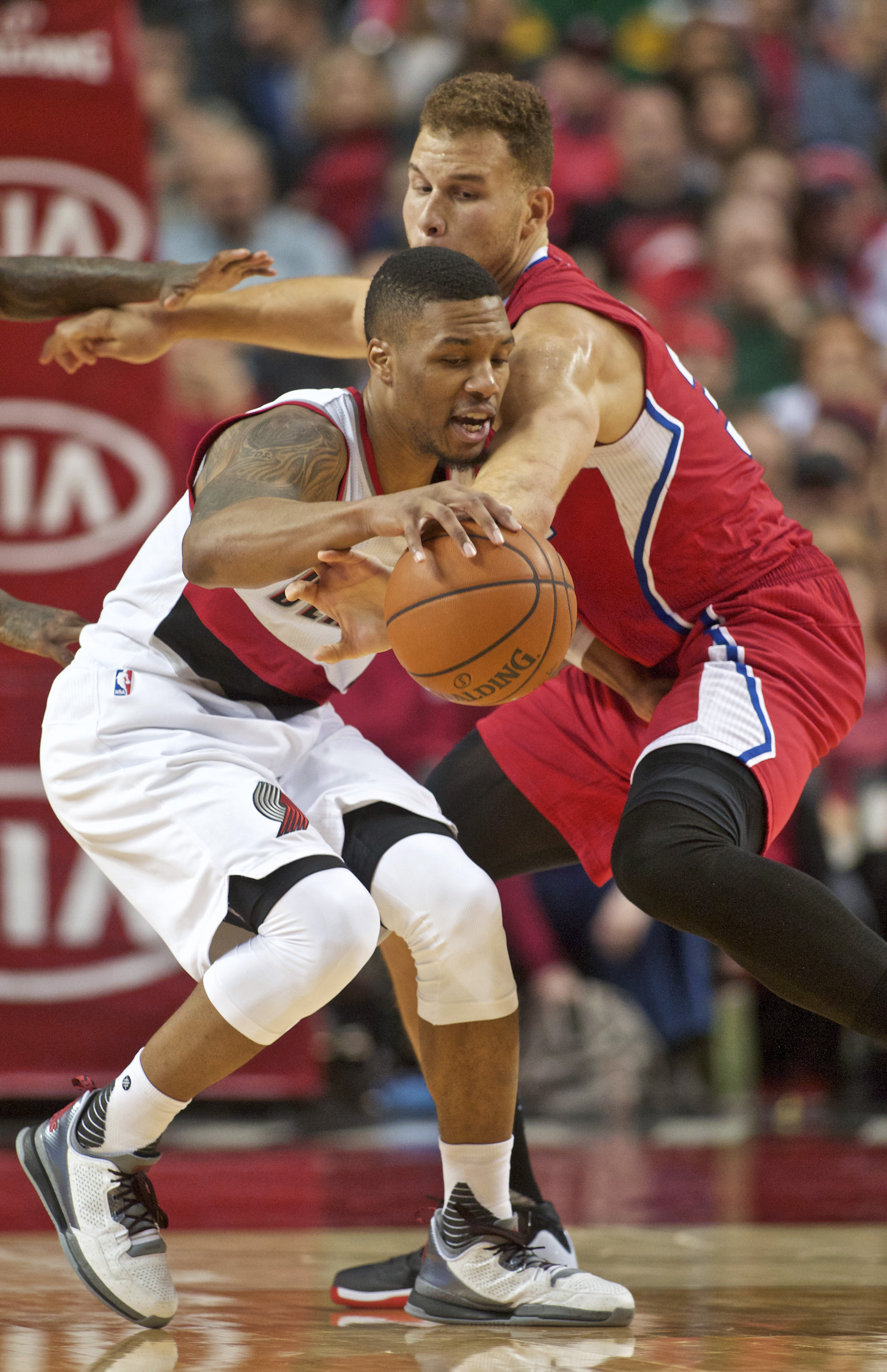 Portland Trail Blazers guard Damian Lillard, left, and Los Angeles Clippers forward Blake Griffin, right collide during the second half of an NBA basketball game in Portland, Ore., Friday, Nov. 20, 2015. Portland won 102-91. (AP Photo/Craig Mitchelldyer)
