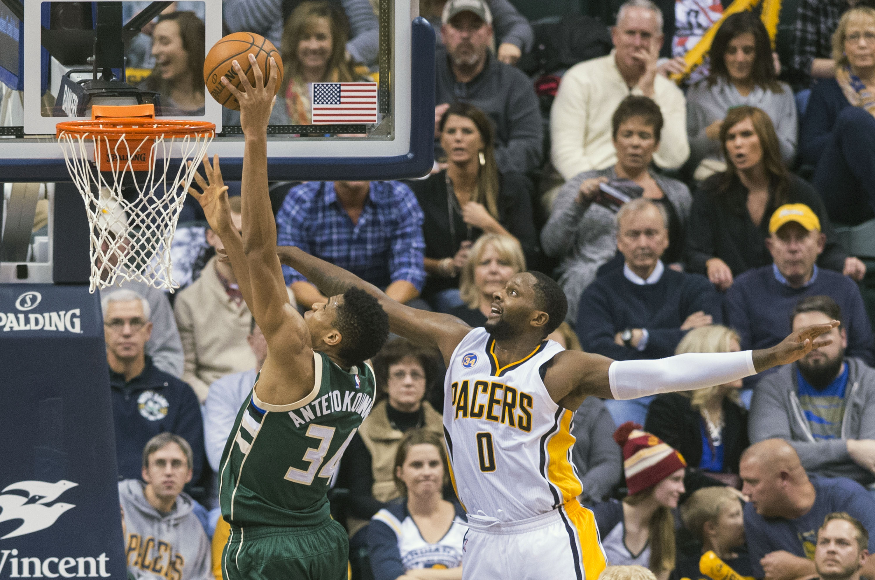 Milwaukee Bucks forward Giannis Antetokounmpo (34) beats Indiana Pacers forward C.J. Miles (0) to the basket to score during the second half of an NBA basketball game, Saturday, Nov. 21, 2015, in Indianapolis. The Pacers won 123-86. (AP Photo/Doug McSchoo