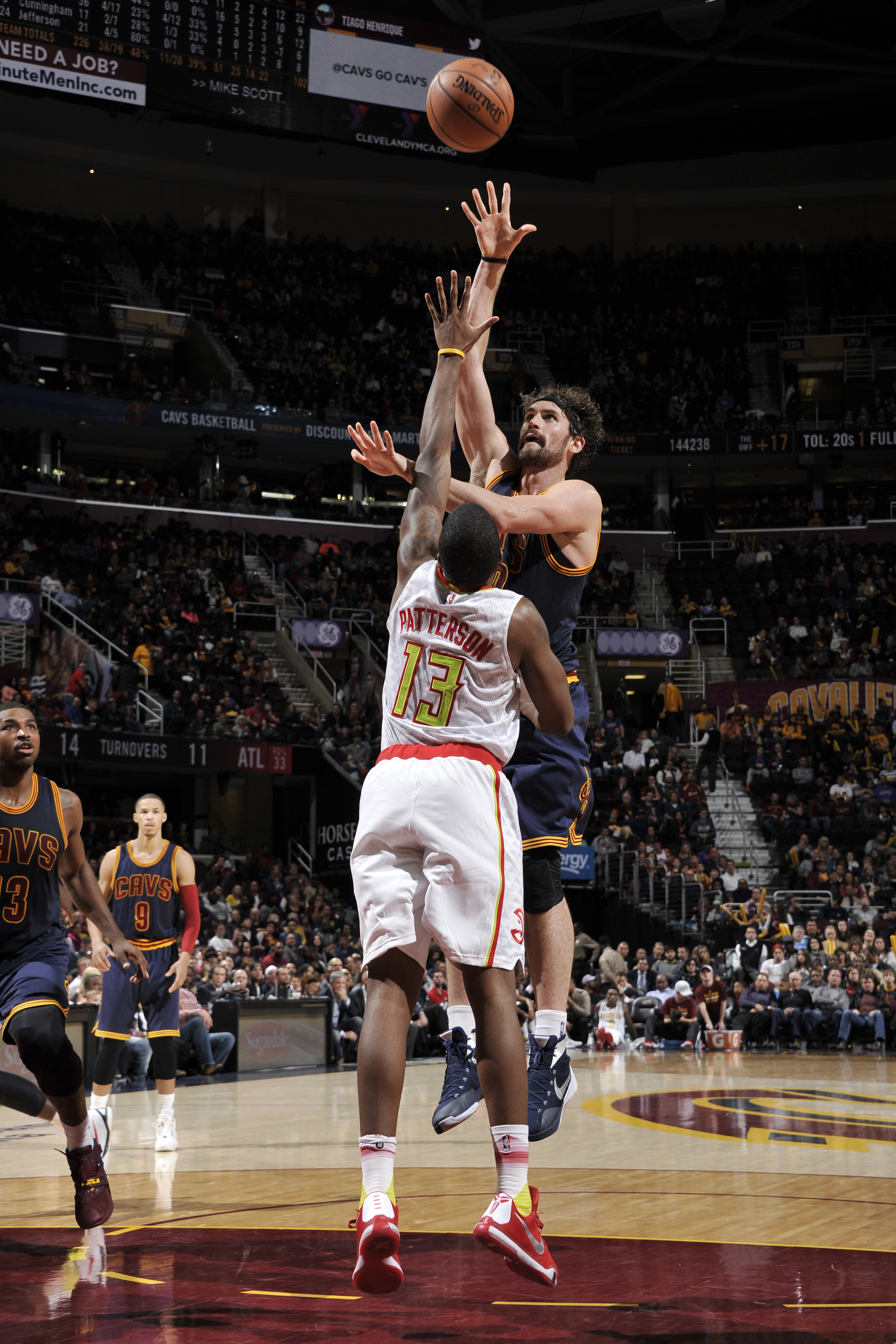 CLEVELAND, OH - NOVEMBER 21:  Kevin Love #0 of the Cleveland Cavaliers shoots against Lamar Patterson #13 of the Atlanta Hawks on November 21, 2015 at Quicken Loans Arena in Cleveland, Ohio. (Photo by David Liam Kyle/NBAE via Getty Images)