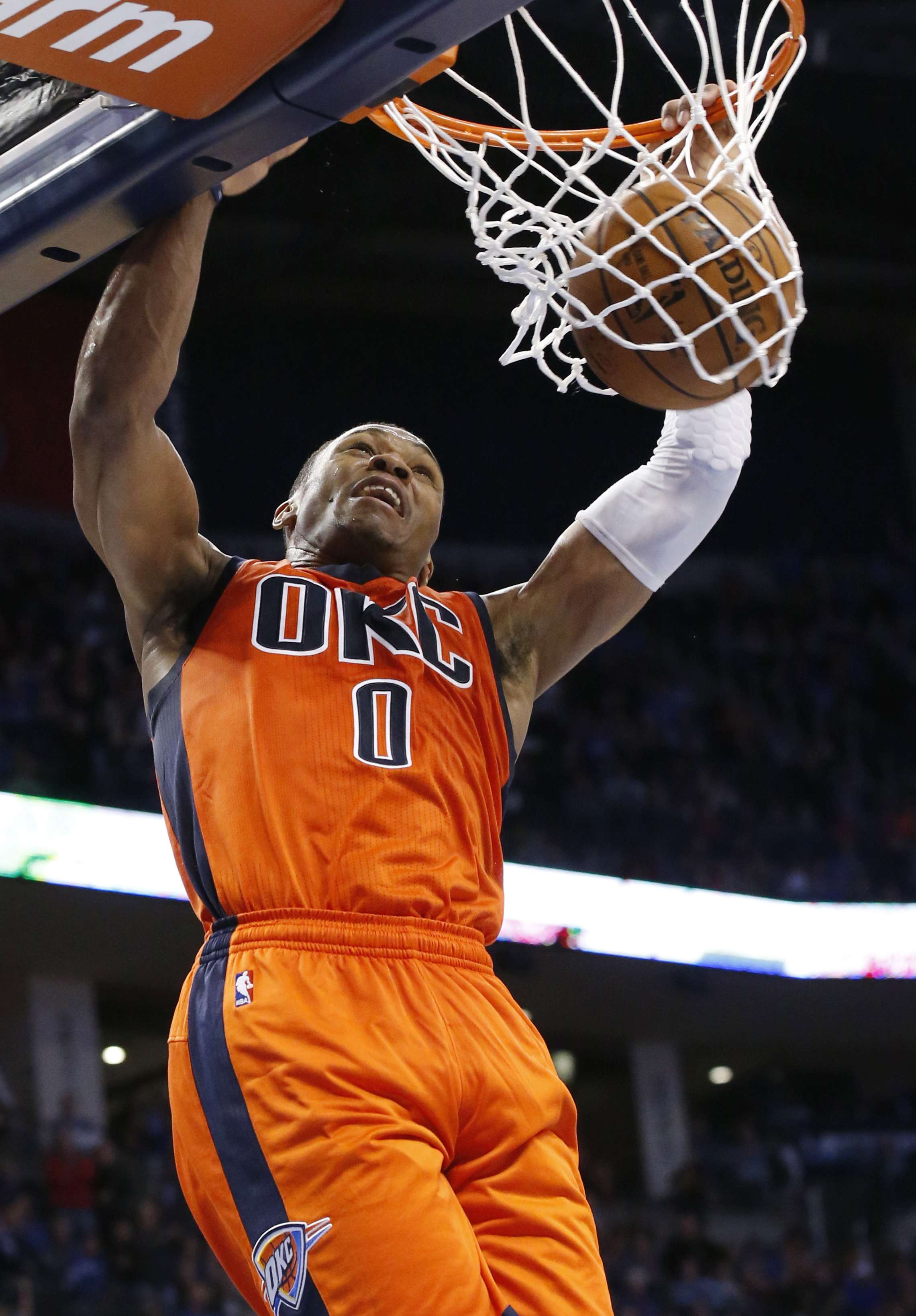 Oklahoma City Thunder guard Russell Westbrook dunks during the fourth quarter of an NBA basketball game against the Dallas Mavericks in Oklahoma City, Sunday, Nov. 22, 2015. Oklahoma City won 117-114. (AP Photo/Sue Ogrocki)