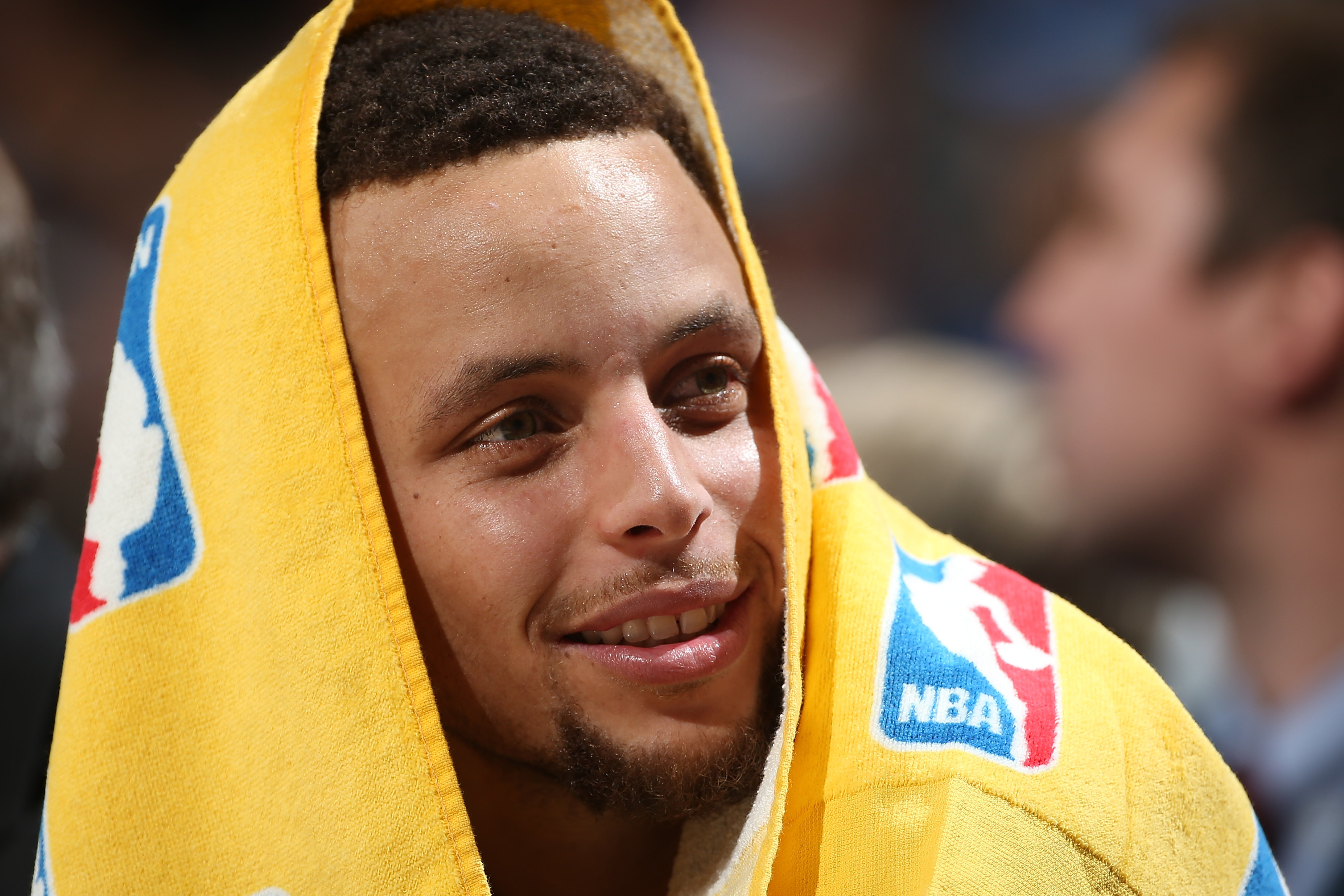 DENVER, CO - NOVEMBER 22:  Stephen Curry #30 of the Golden State Warriors looks on from the bench against the Denver Nuggets at Pepsi Center on November 22, 2015 in Denver, Colorado. The Warriors defeated the Nuggets 118-105 to start the season 15-0. (Pho