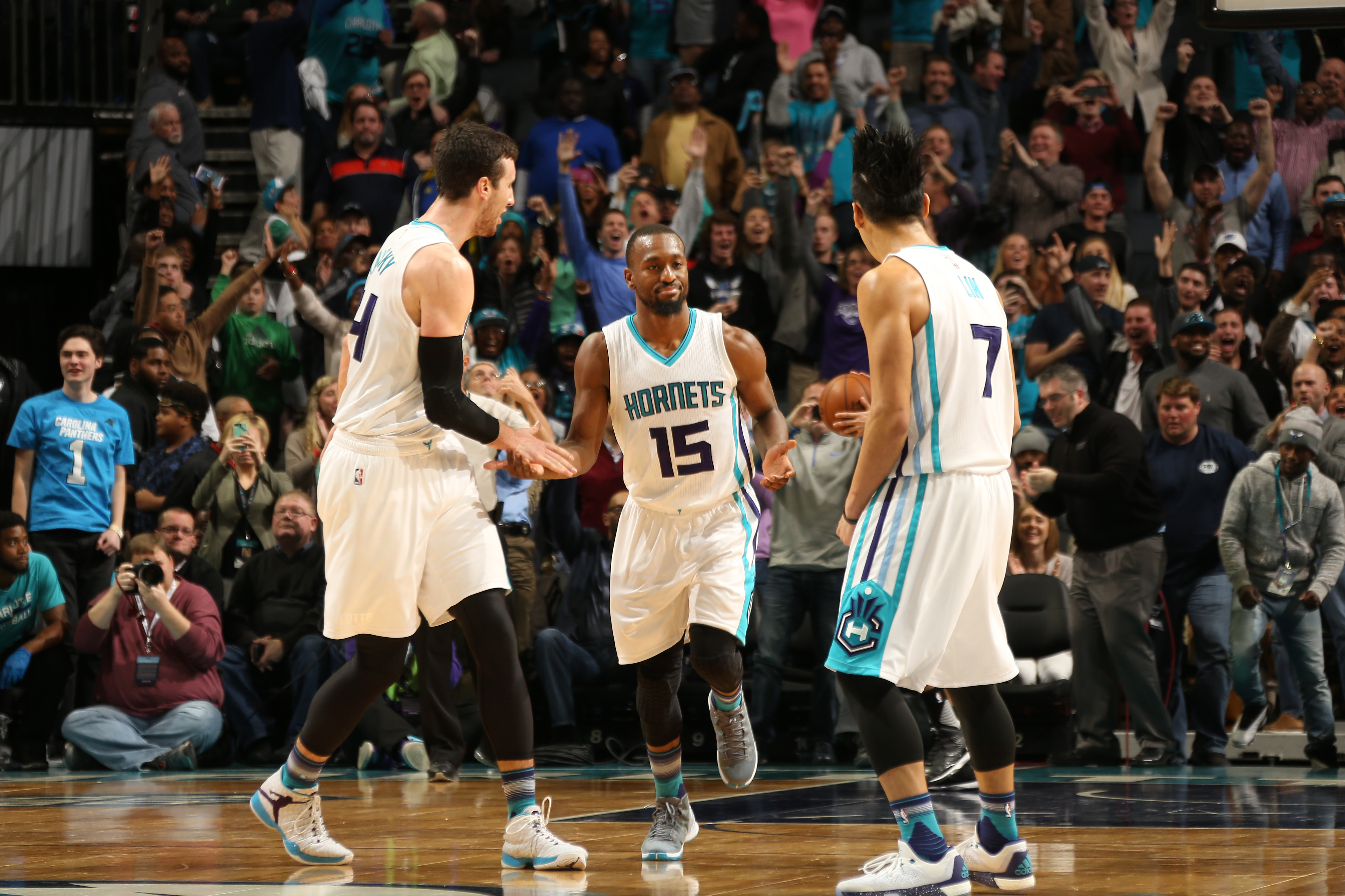 CHARLOTTE, NC - NOVEMBER 23: Kemba Walker #15 of the Charlotte Hornets high fives his teammates during the game against the Sacramento Kings on November 23, 2015 at Time Warner Cable Arena in Charlotte, North Carolina. (Photo by Kent Smith/NBAE via Getty