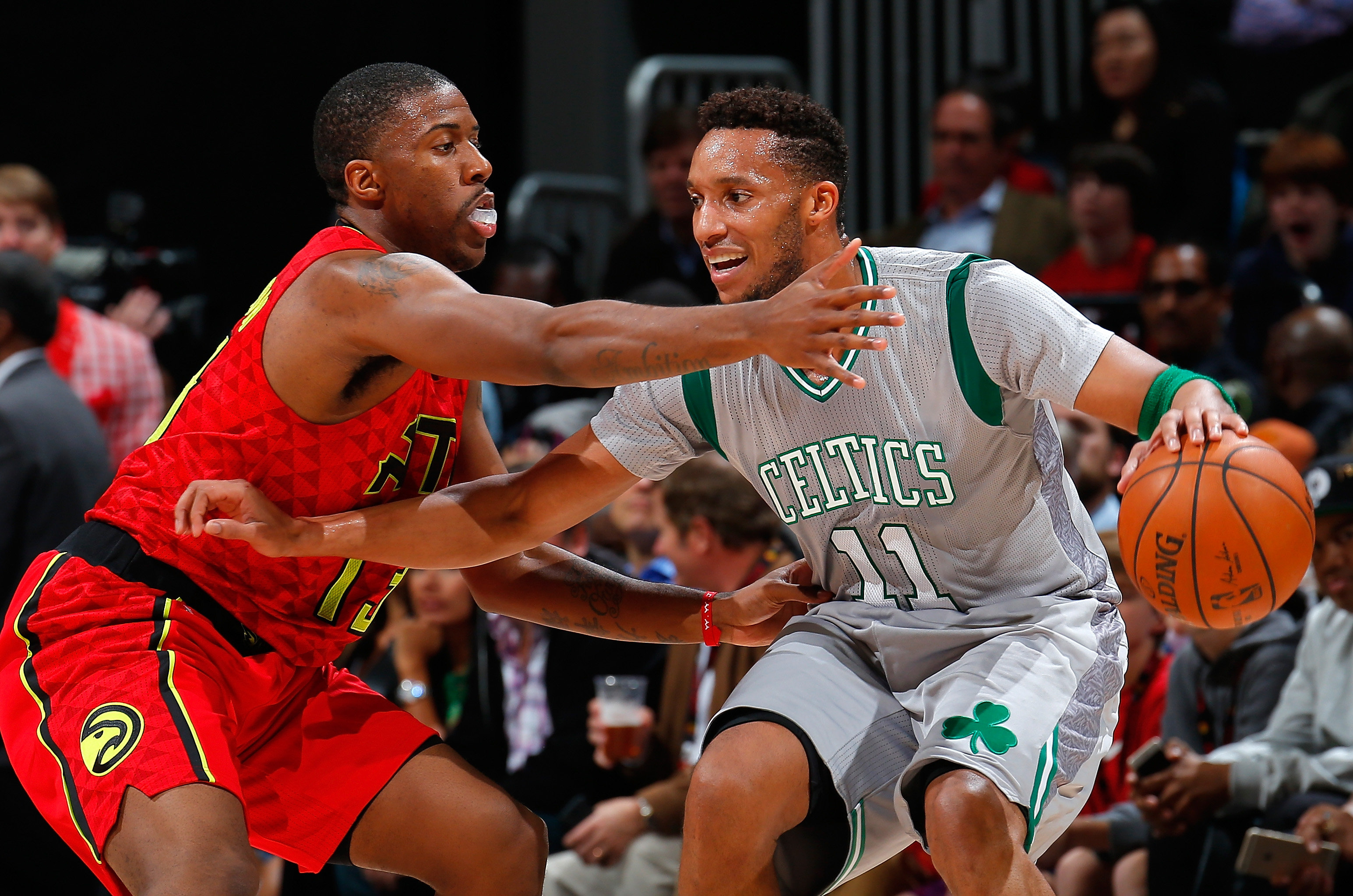 ATLANTA, GA - NOVEMBER 24:  Lamar Patterson #13 of the Atlanta Hawks defends against Evan Turner #11 of the Boston Celtics at Philips Arena on November 24, 2015 in Atlanta, Georgia.  NOTE TO USER User expressly acknowledges and agrees that, by downloading