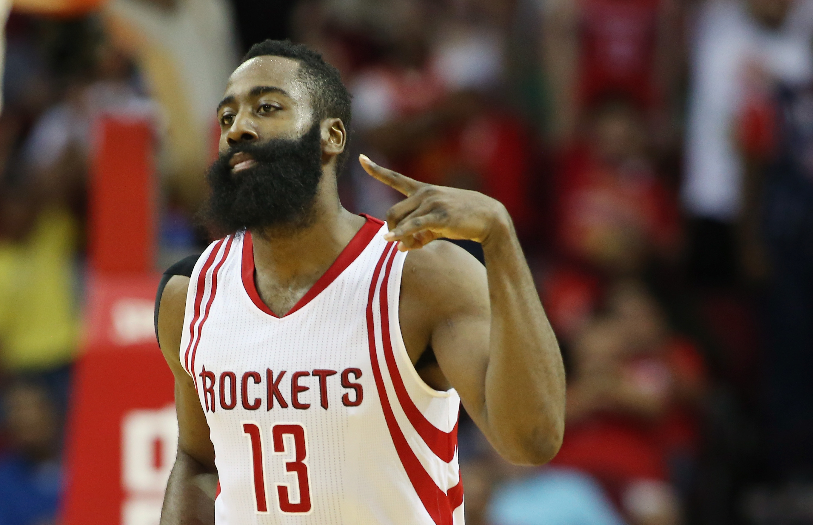 HOUSTON, TX - NOVEMBER 27:  James Harden #13 of the Houston Rockets celebrates after a three-point shot during their game against the Philadelphia 76ers at the Toyota Center on November 27, 2015 in Houston, Texas.  (Photo by Scott Halleran/Getty Images)