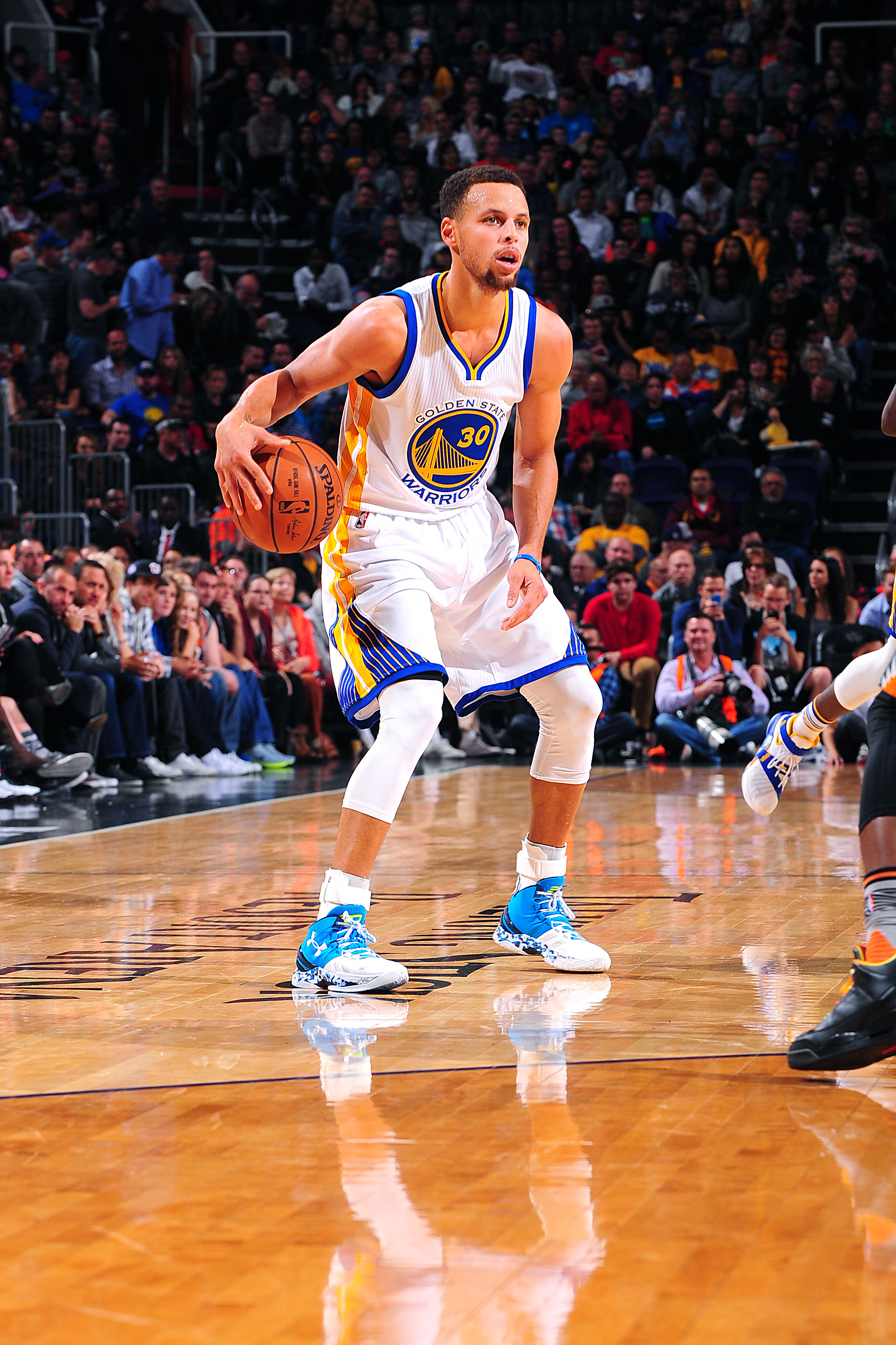 PHOENIX, AZ - NOVEMBER 27: Stephen Curry #30 of the Golden State Warriors handles the ball during the game against the Phoenix Suns on November 27, 2015 at U.S. Airways Center in Phoenix, Arizona. (Photo by Barry Gossage/NBAE via Getty Images)