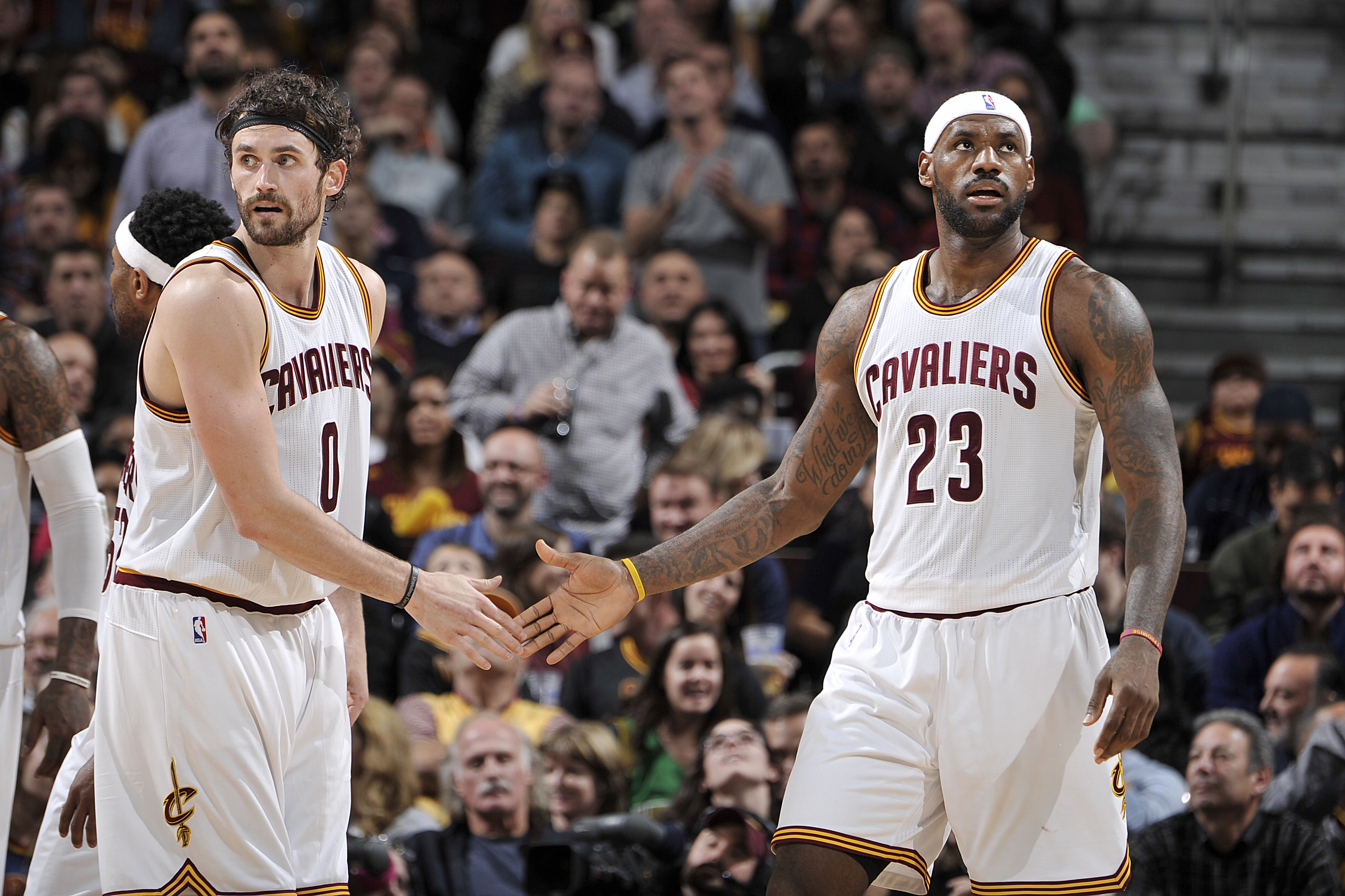 CLEVELAND, OH - NOVEMBER 28: LeBron James #23 and Kevin Love #0 of the Cleveland Cavaliers high five each other during the game against the Brooklyn Nets on November 28, 2015 at Quicken Loans Arena in Cleveland, Ohio.  (Photo by David Liam Kyle/NBAE via G