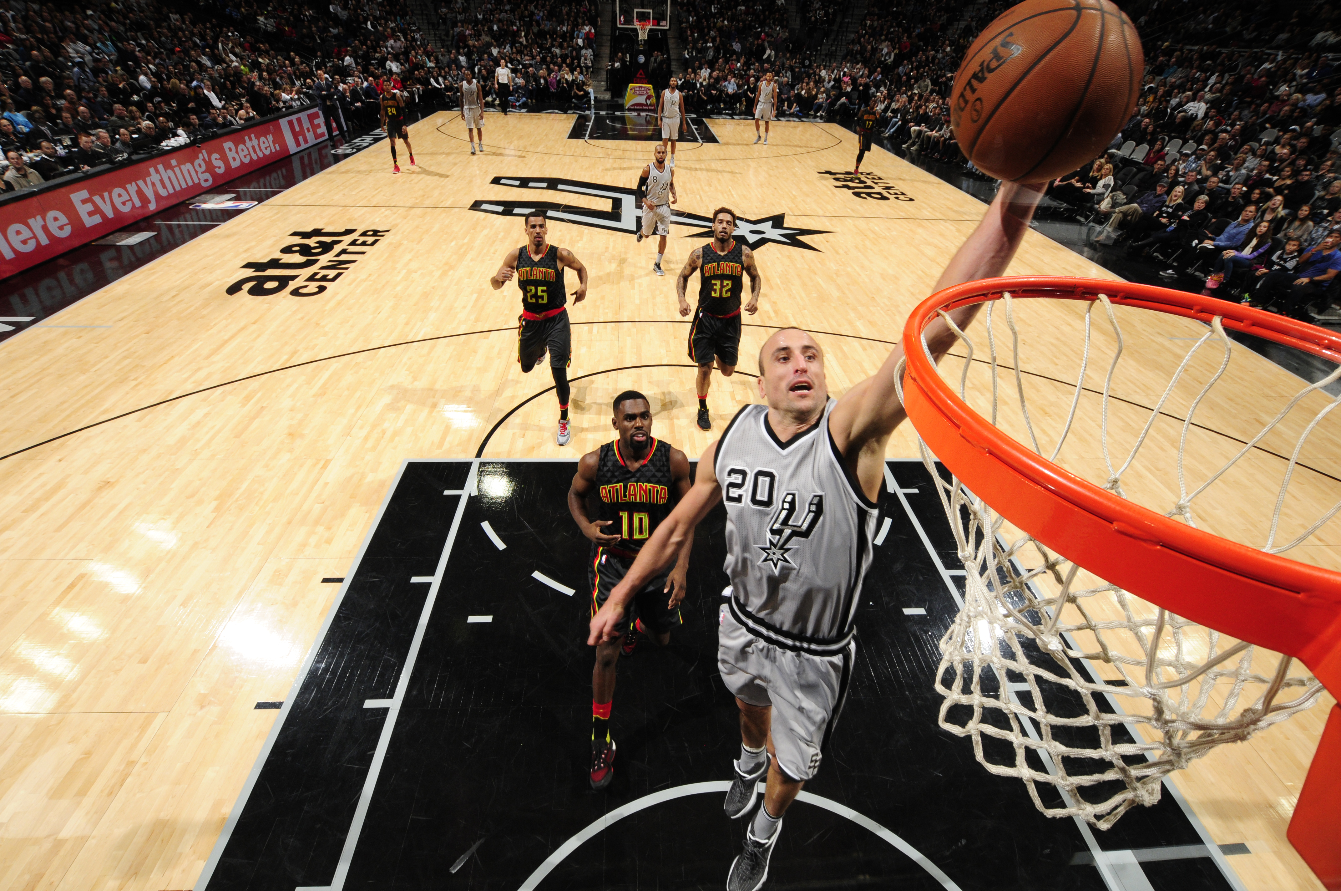 SAN ANTONIO, TX - NOVEMBER 28:  Manu Ginobili #20 of the San Antonio Spurs goes to the basket against the Atlanta Hawks on November 28, 2015 at the AT&T Center in San Antonio, Texas.