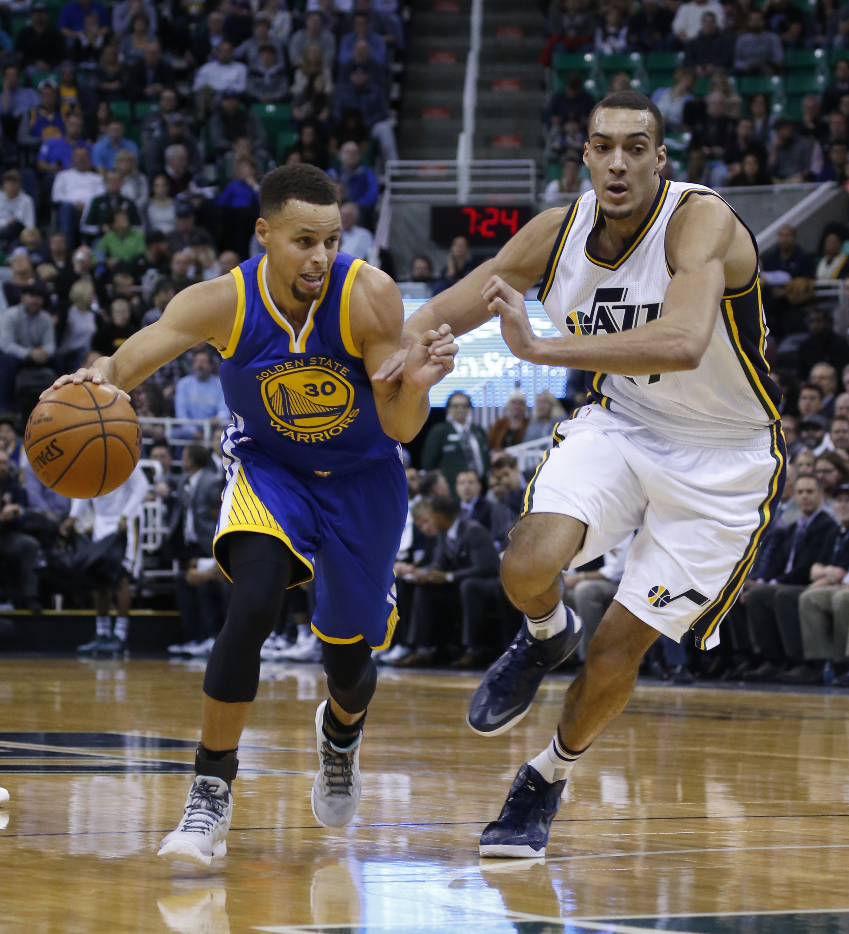 SALT LAKE CITY, UT - NOVEMBER 30: Guard Stephen Curry #30 of the Golden State Warriors drives past  Center Rudy Gobert #27 of the Utah Jazz during the first half of an NBA game November 30, 2014 at Vivint Smart Home Arena in Salt Lake City, Utah. (Photo b