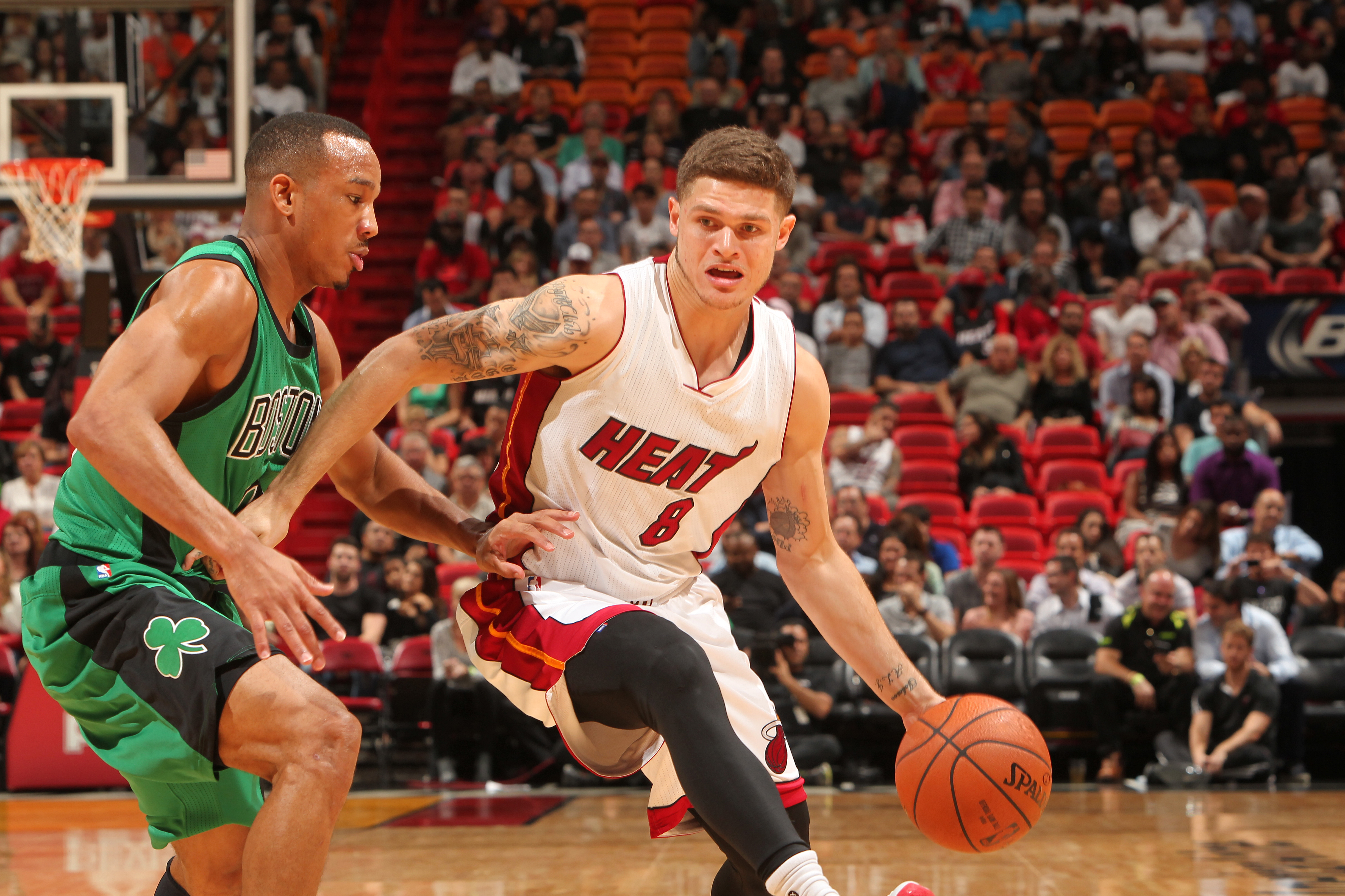 MIAMI, FL - NOVEMBER 30: Tyler Johnson #8 of the Miami Heat handles the ball against the Boston Celtics on November 30, 2015 at American Airlines Arena in Miami, Florida.  (Photo by Victor Baldizon/NBAE via Getty Images)