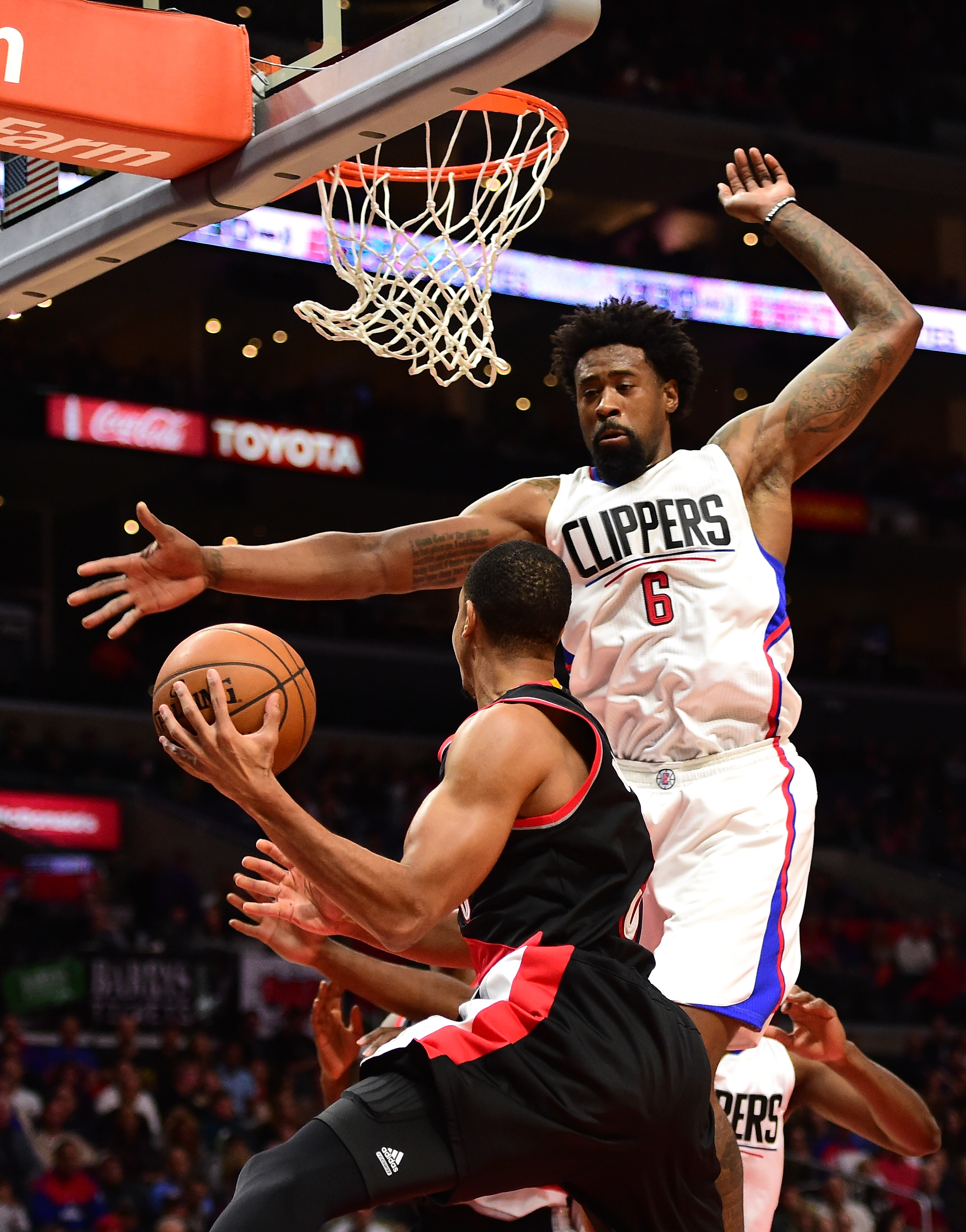 LOS ANGELES, CA - NOVEMBER 30:  DeAndre Jordan #6 of the Los Angeles Clippers attempts a block on C.J. McCollum #3 of the Portland Trail Blazers during the first half at Staples Center on November 30, 2015 in Los Angeles, California.  (Photo by Harry How/